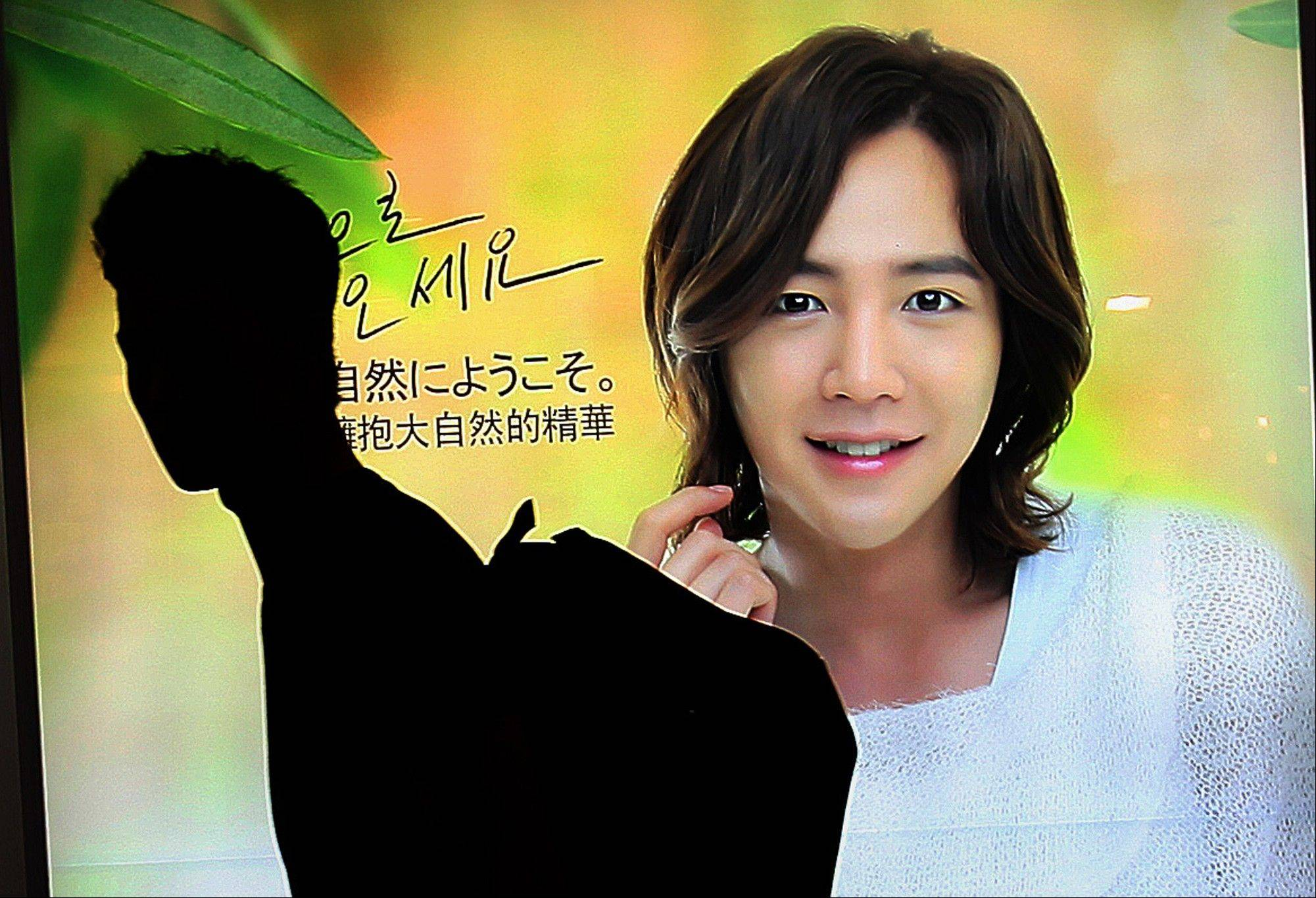 A man walks by an advertisement featuring Jang Keun-suk, a South Korean celebrity often given the title �flower man� by news media in Seoul, South Korea. The metamorphosis of South Korean men from macho to makeup over the last decade or so can be partly explained by fierce competition for jobs, advancement and romance in a society where, as a popular catchphrase puts it, �appearance is power.�