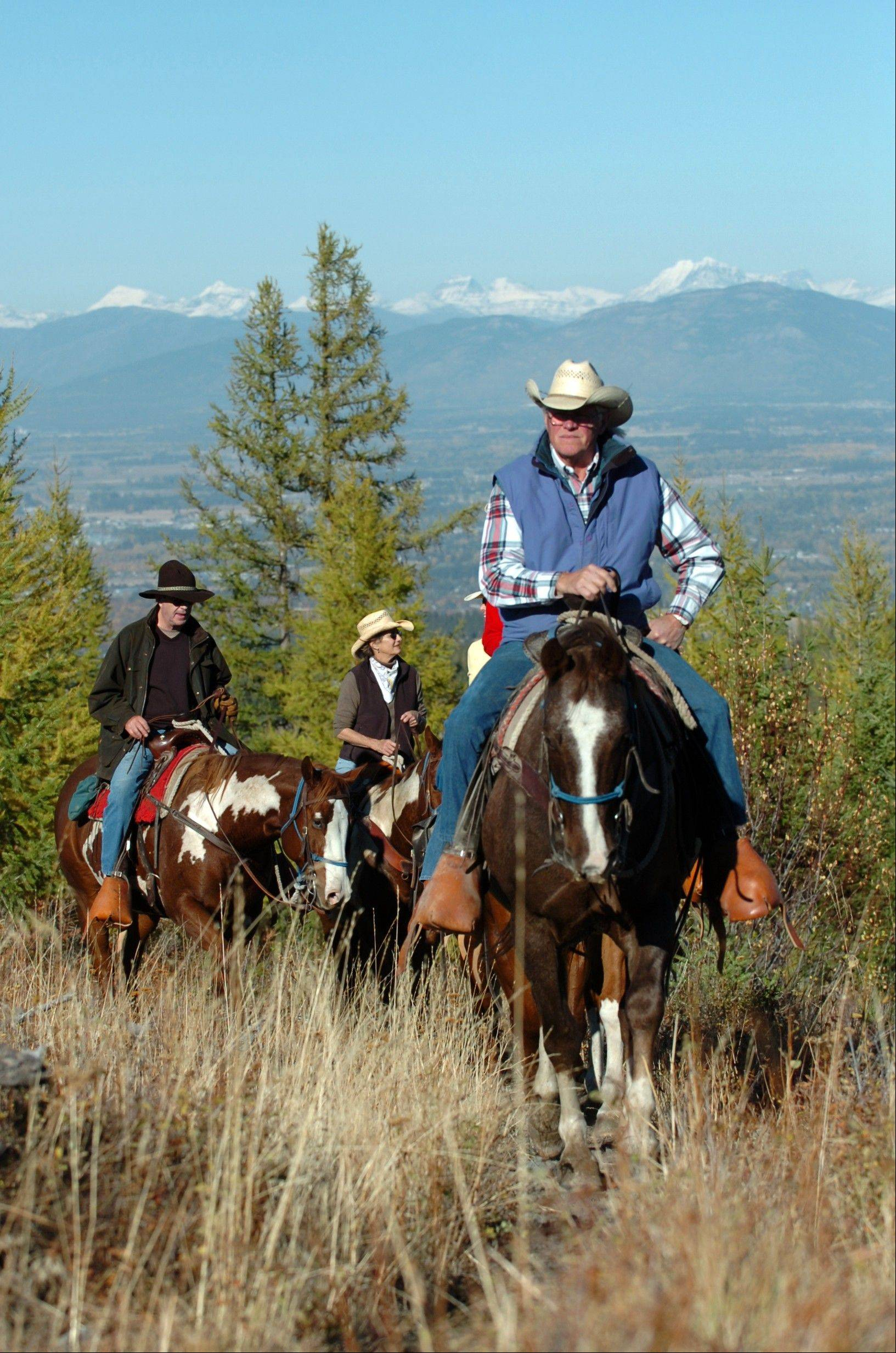 Cecil Noble, co-owner of Artemis Acres ranch, leads riders Bill and Sally Herndon of Bigfork up a mountain southwest of Kalispell, Mont. The idea of people who uproot and move when they retire conjures up images of warm, sunny Florida or Arizona. But some of the older members of the baby boom generation � the 78 million Americans born between 1946 and 1964 � are looking elsewhere, and a number of towns in cooler climates from Maine to Washington have become popular retirement destinations.