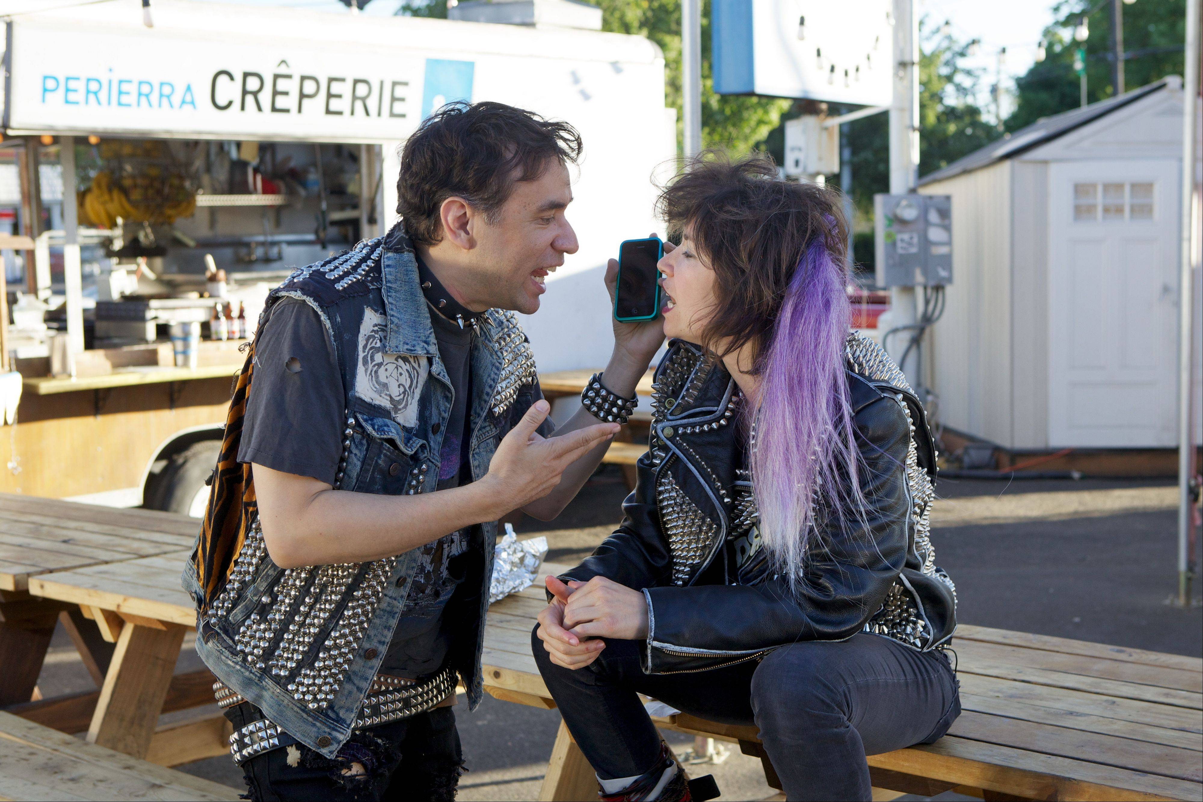 Fred Armisen, left, and Carrie Brownstein appear in a scene from the IFC series �Portlandia.� Armisen�s famous quip on the show that Portland is �a city where young people go to retire,� led Portland State University researchers to investigate the reality behind the comment.