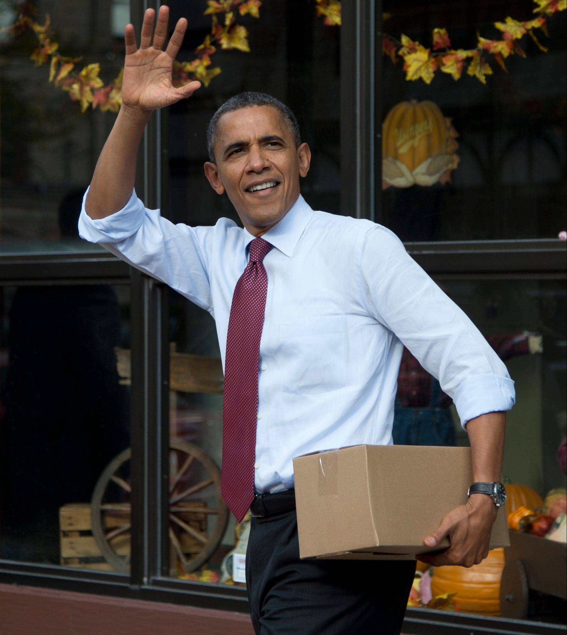 Like his Republican rival Mitt Romney, President Barack Obama is trying to coax undecided voters to side with him � even if it takes buying a box of bratwurst sausages, as Obama is seen doing above Saturday in Milwaukee.