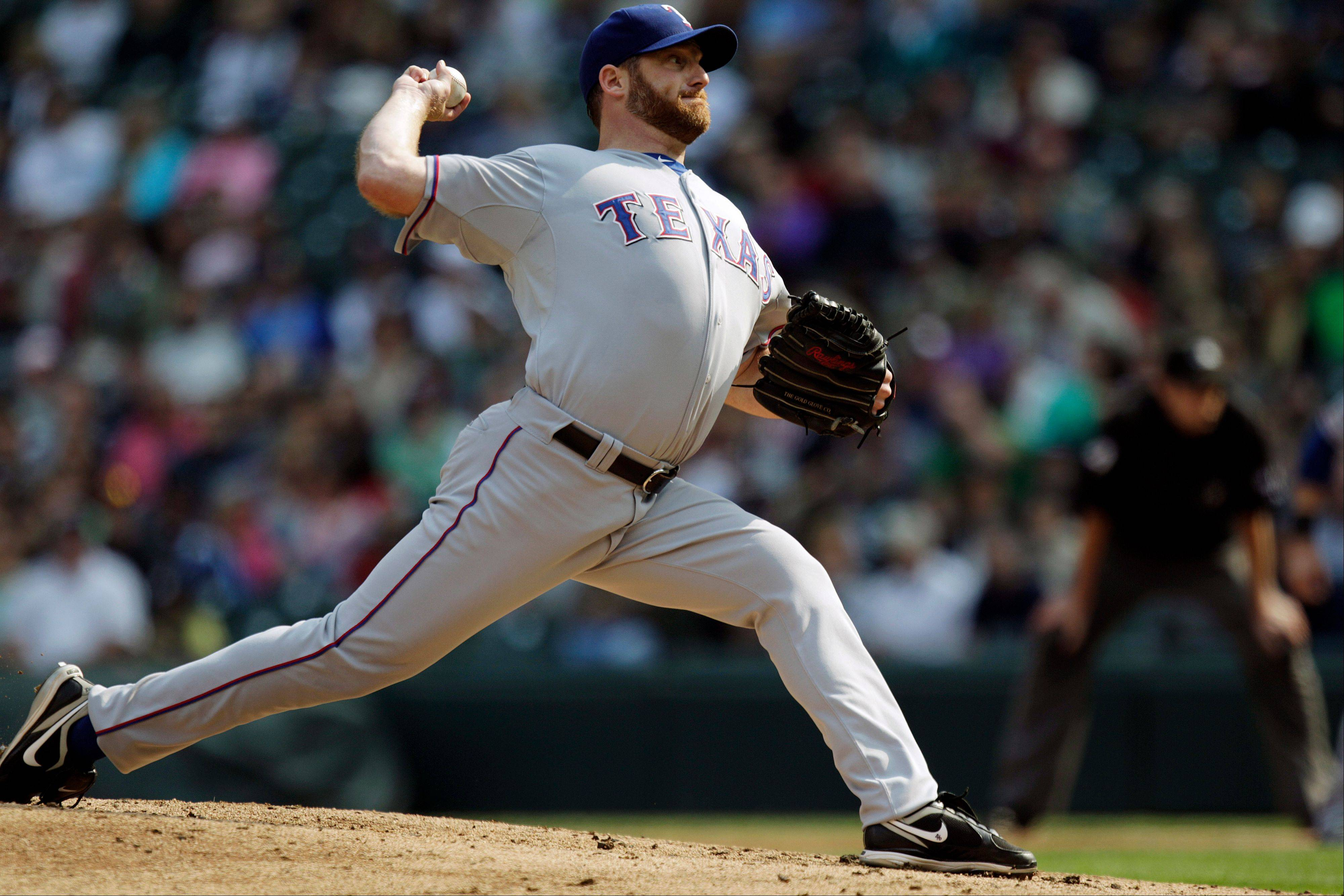Texas Rangers starting pitcher Ryan Dempster struck out eight Sunday in a road win over Seattle.