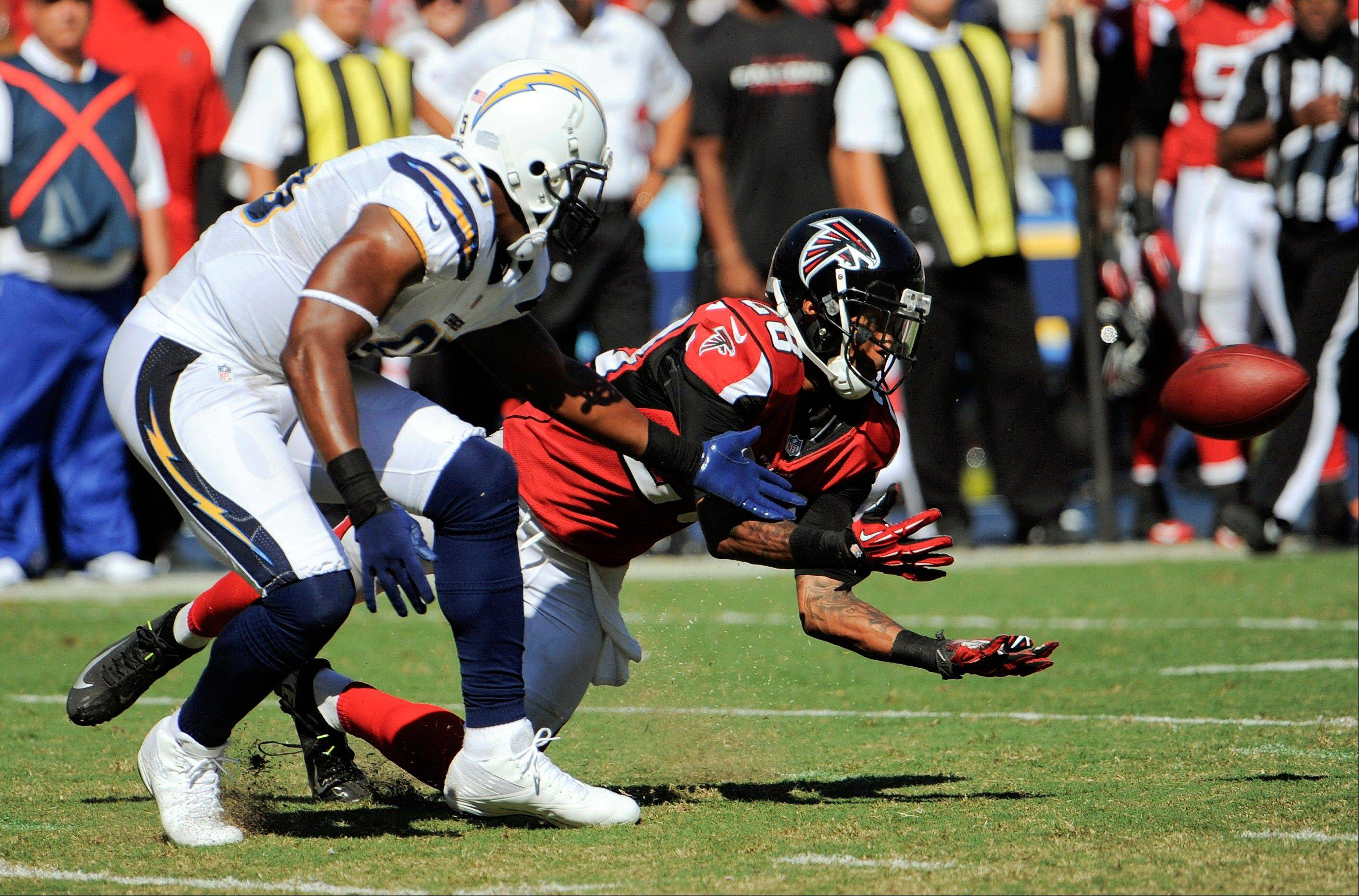 Atlanta Falcons free safety Thomas DeCoud intercepts a pass intended for San Diego Chargers tight end Antonio Gates during the second half Sunday in San Diego.