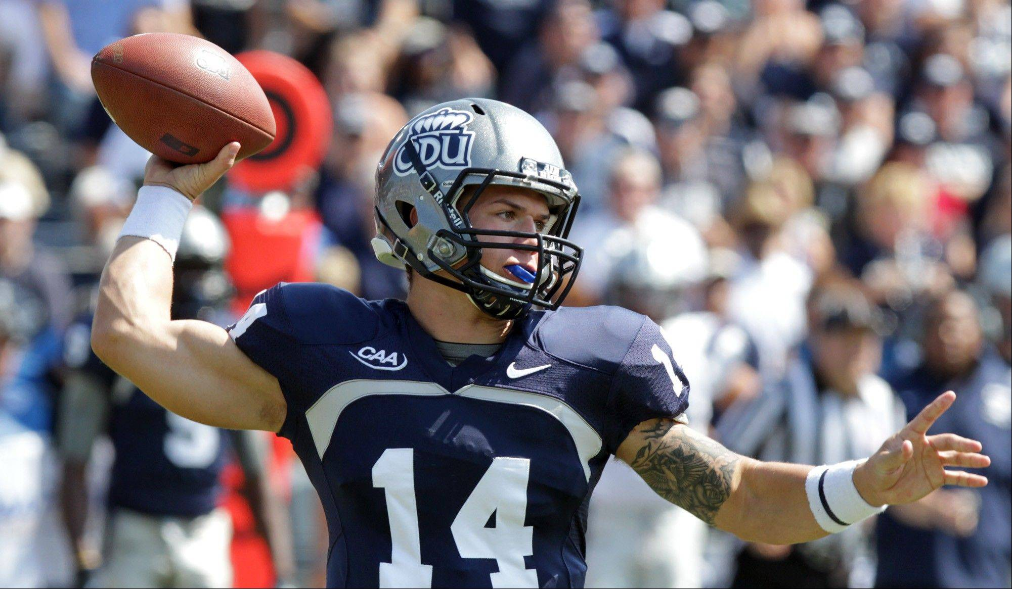 Old Dominion quarterback Taylor Heinicke throws a pass against New Hampshire on Saturday in Norfolk, Va. Heinicke set an NCAA record for passing yards (730) in the game.