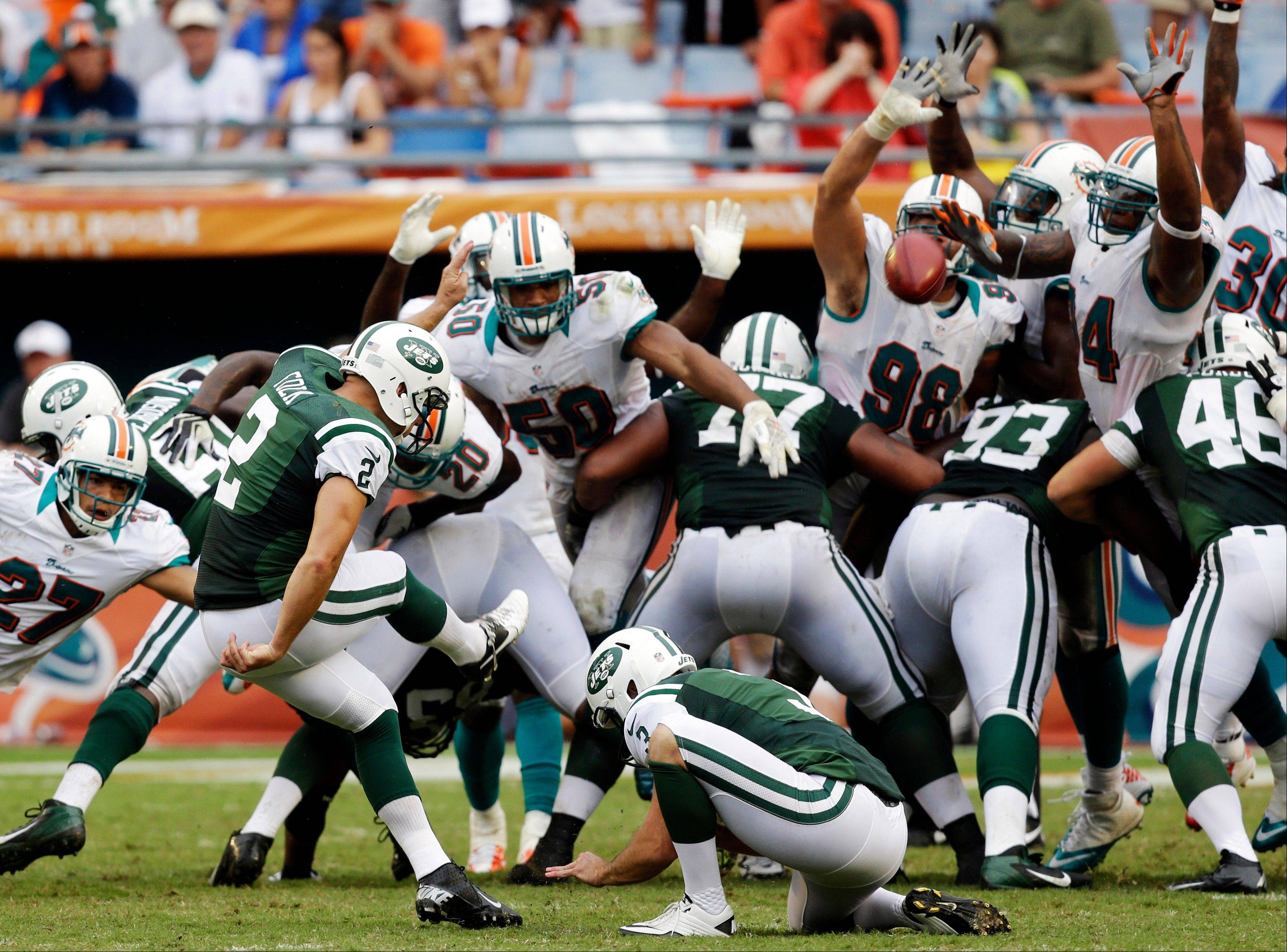New York Jets kicker Nick Folk makes the game-winning field goal in overtime to defeat the Miami Dolphins 23-20 on Sunday in Miami.