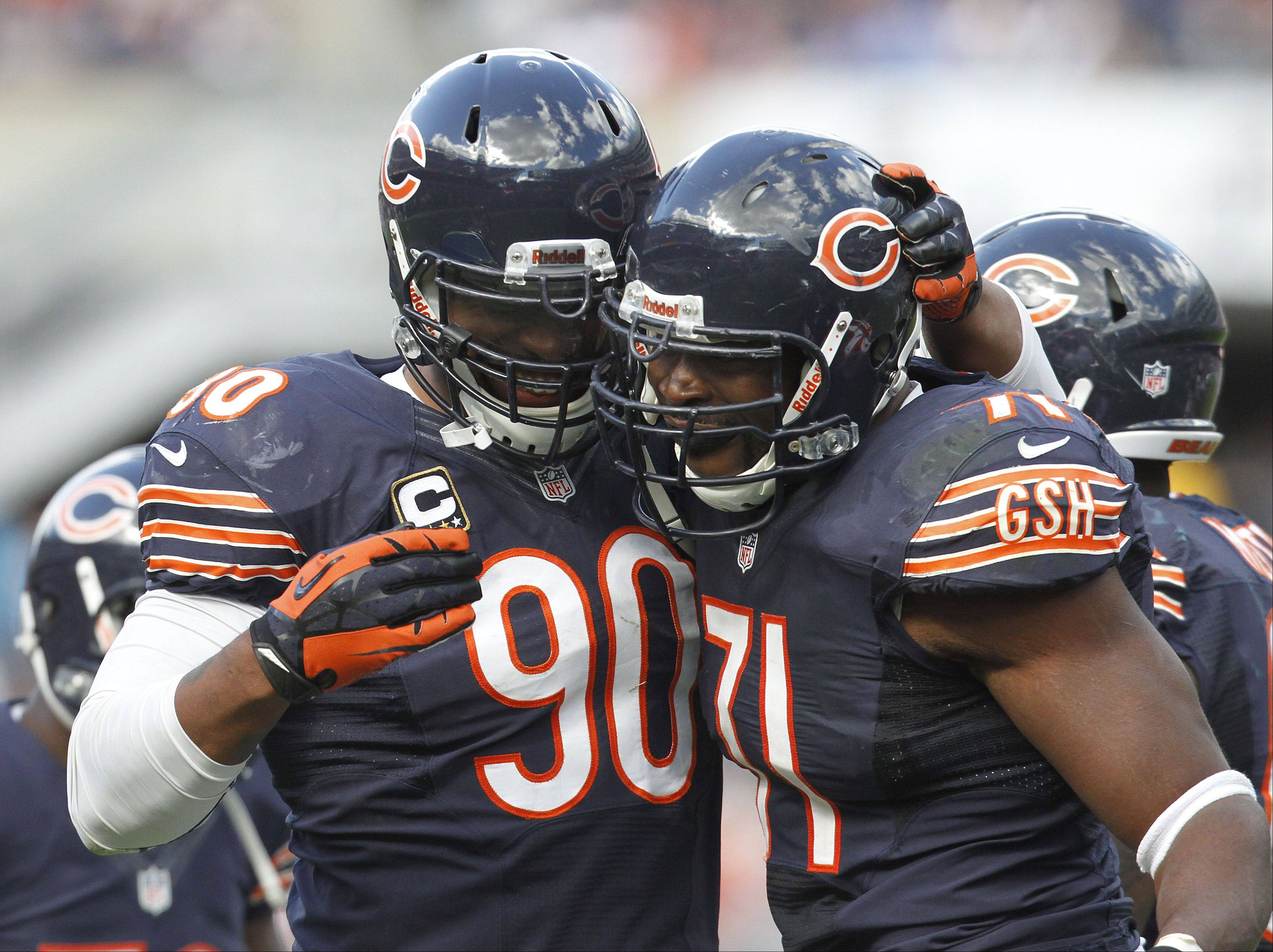 Chicago Bears defensive end Julius Peppers celebrates with defensive end Israel Idonije after a sack during the Bears 23-6 win over the St. Louis Rams Sunday at Soldier Field in Chicago.