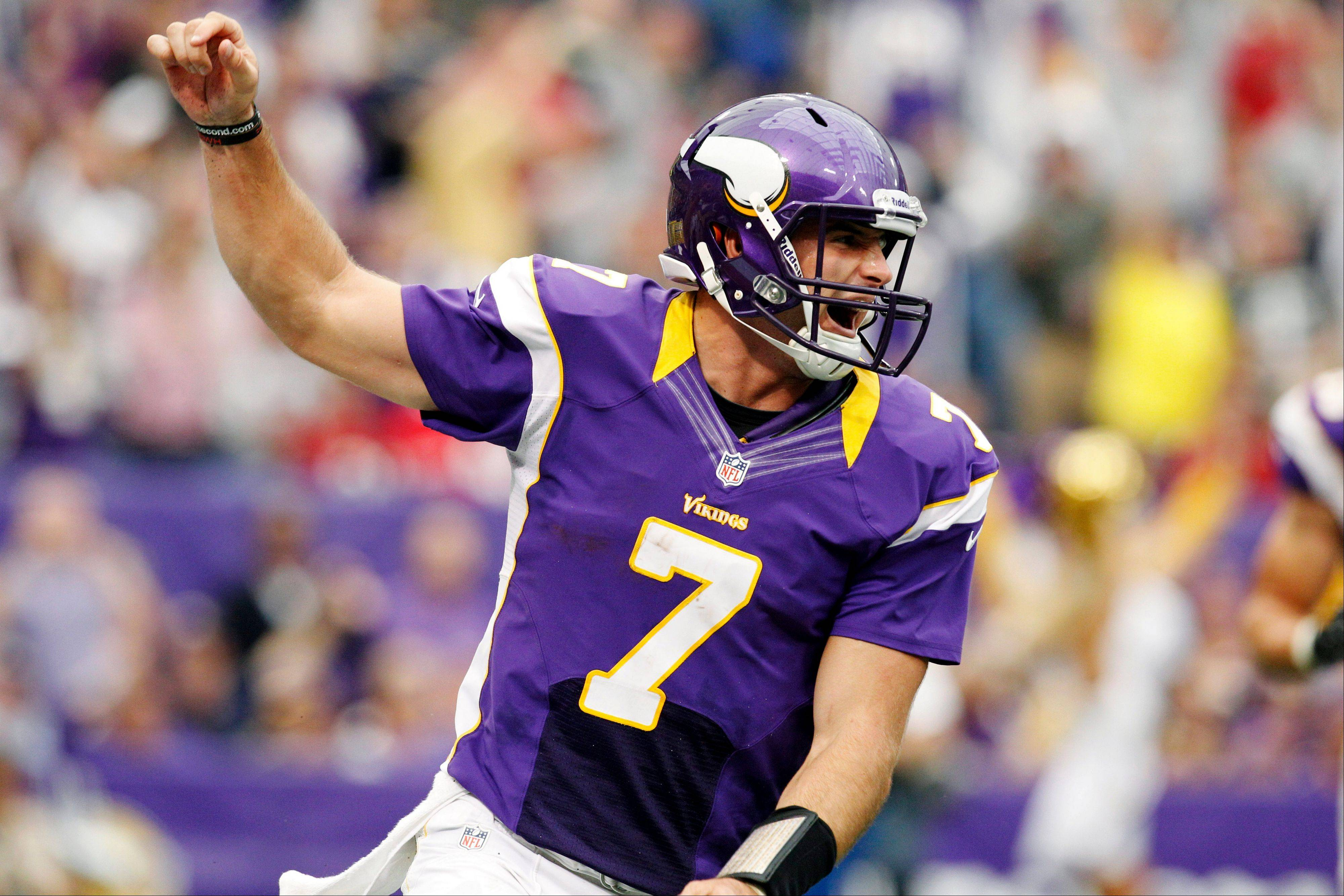 Minnesota quarterback Christian Ponder celebrates his touchdown run in the first half Sunday at home against San Francisco.