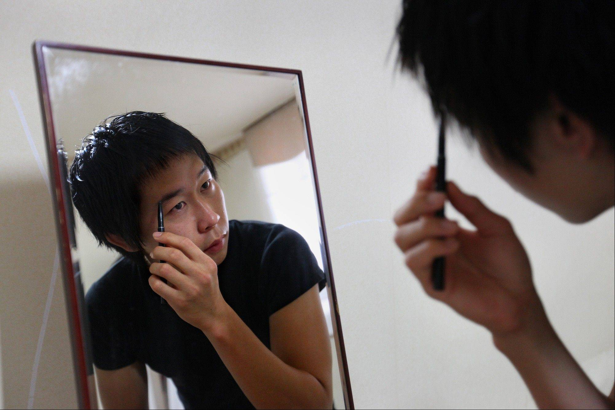 Cho Won-Hyuk, a 24-year-old college student, uses a black eyebrow pencil to lengthen and accentuate his eyebrows at his home Anyang, South Korea. Cho's meticulous efforts to paint the perfect face are not unusual in South Korea. This socially conservative, male-dominated country, with a mandatory two-year military conscription for men, has become the male makeup capital of the world.