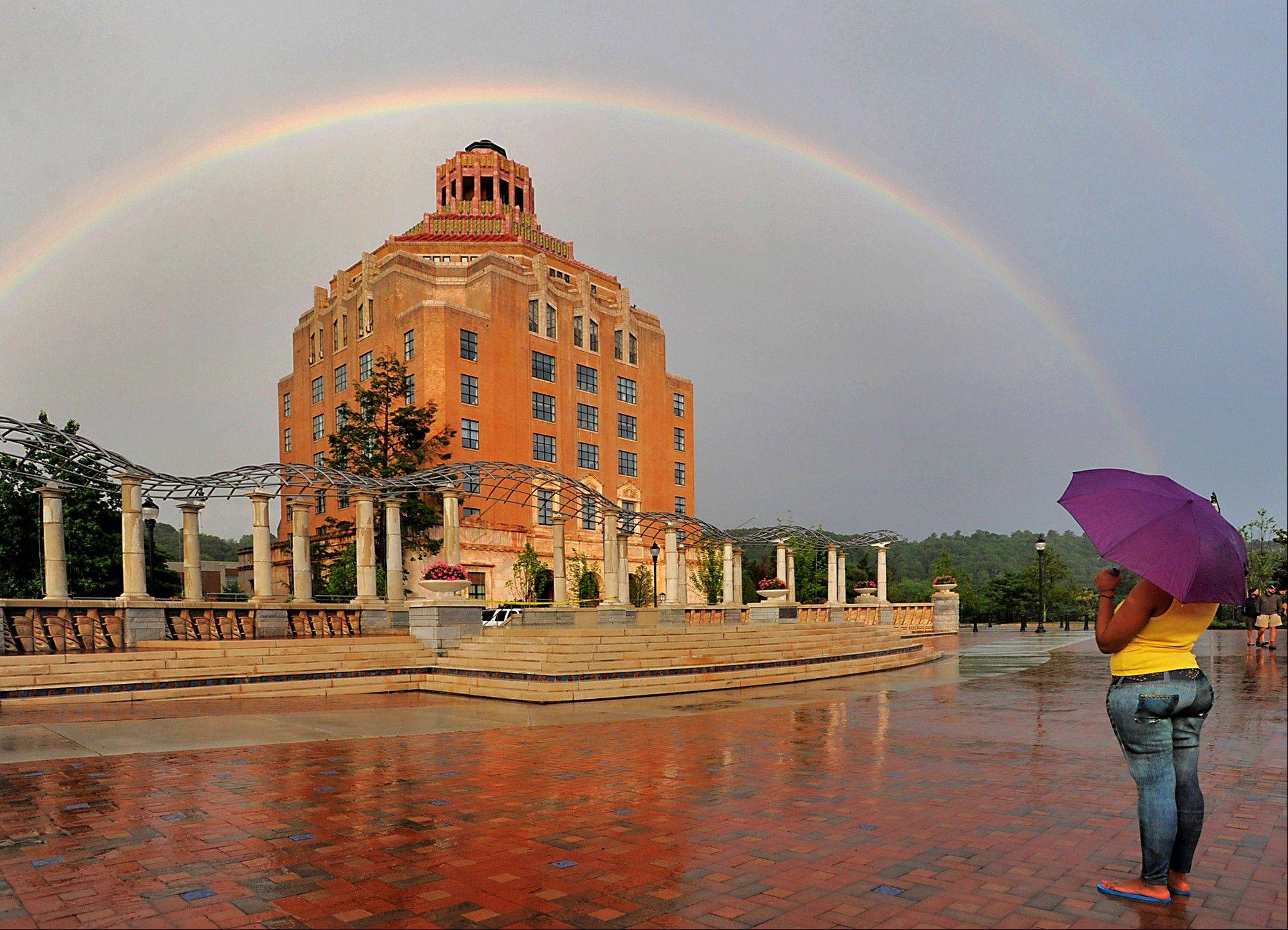 A rainbow forms over the City Hall building in Asheville, N.C. The idea of people who uproot and move when they retire conjures up images of warm, sunny Florida or Arizona. But some of the older members of the baby boom generation -- the 78 million Americans born between 1946 and 1964 -- are looking elsewhere, and a number of towns in cooler climates from Maine to Washington have become popular retirement destinations. Asheville has also merited mention in the lists of best places for retirees.