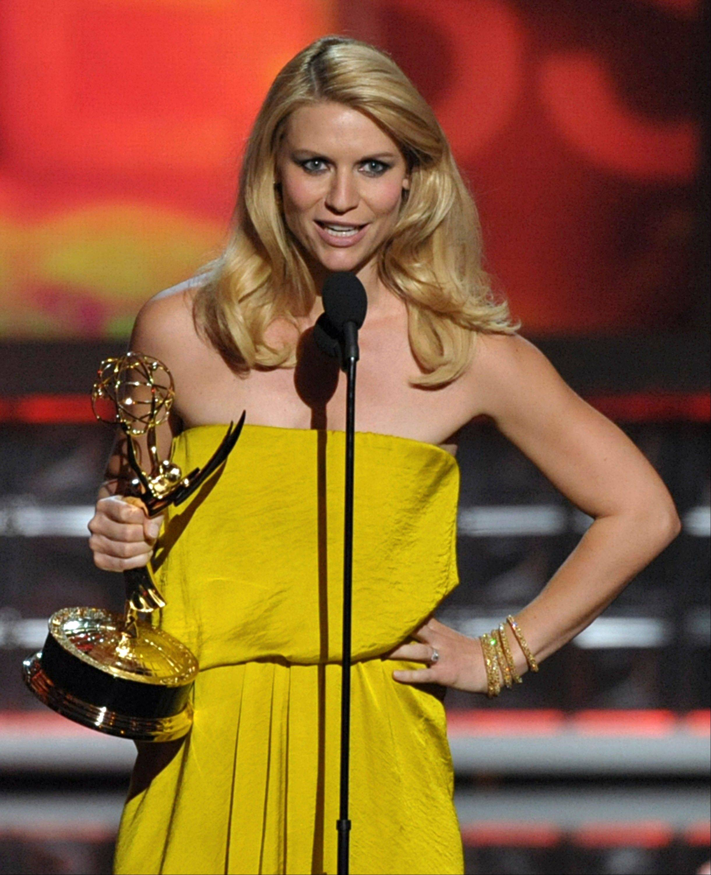 "Claire Danes accepts the award for Outstanding Lead Actress In A Drama Series for ""Homeland"" at the 64th Primetime Emmy Awards at the Nokia Theatre on Sunday in Los Angeles. (Photo by John Shearer/Invision/AP)"