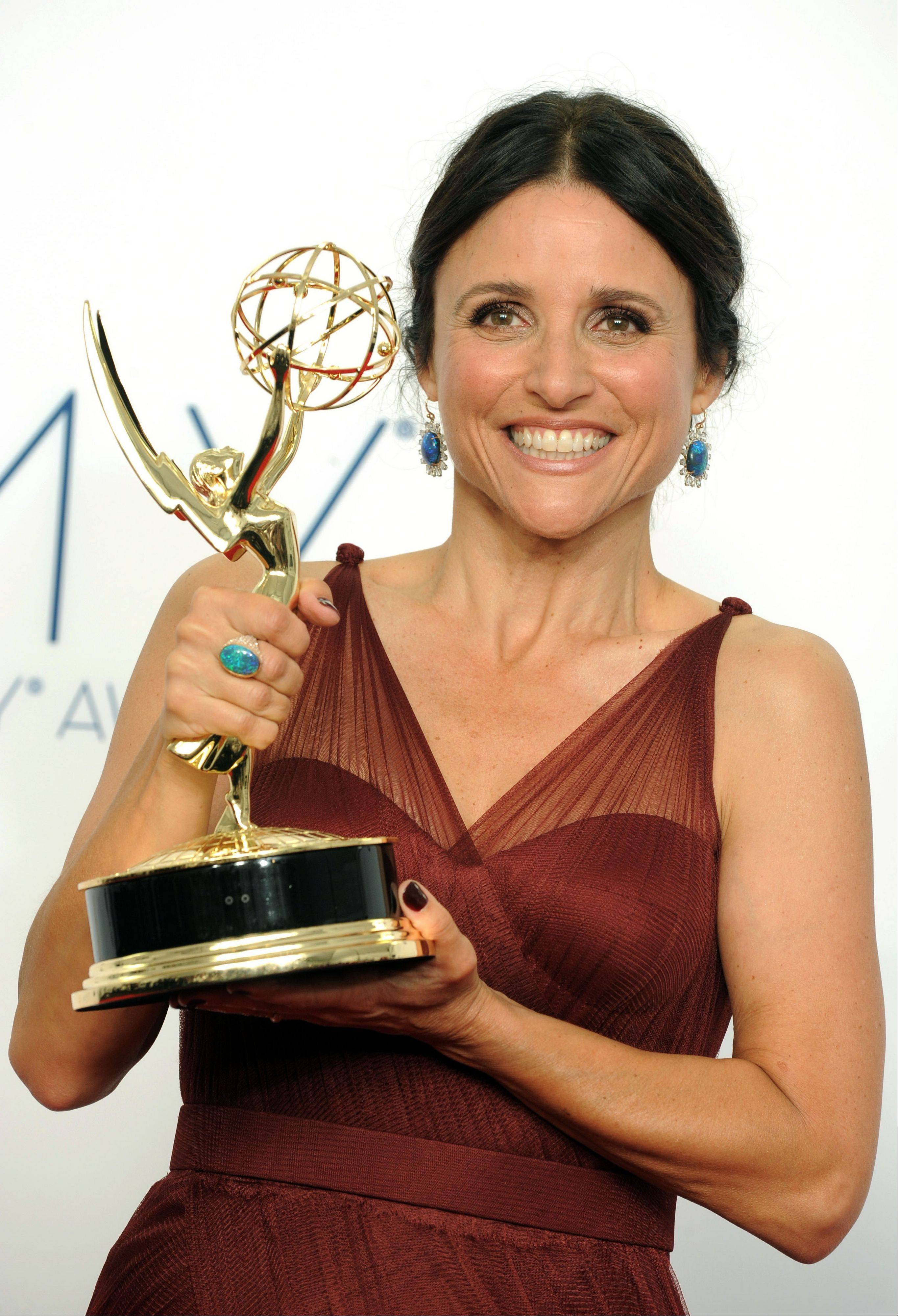 Actress Julia Louis-Dreyfus, winner Outstanding Lead Actress in a Comedy Series, poses backstage at the 64th Primetime Emmy Awards at the Nokia Theatre on Sunday.