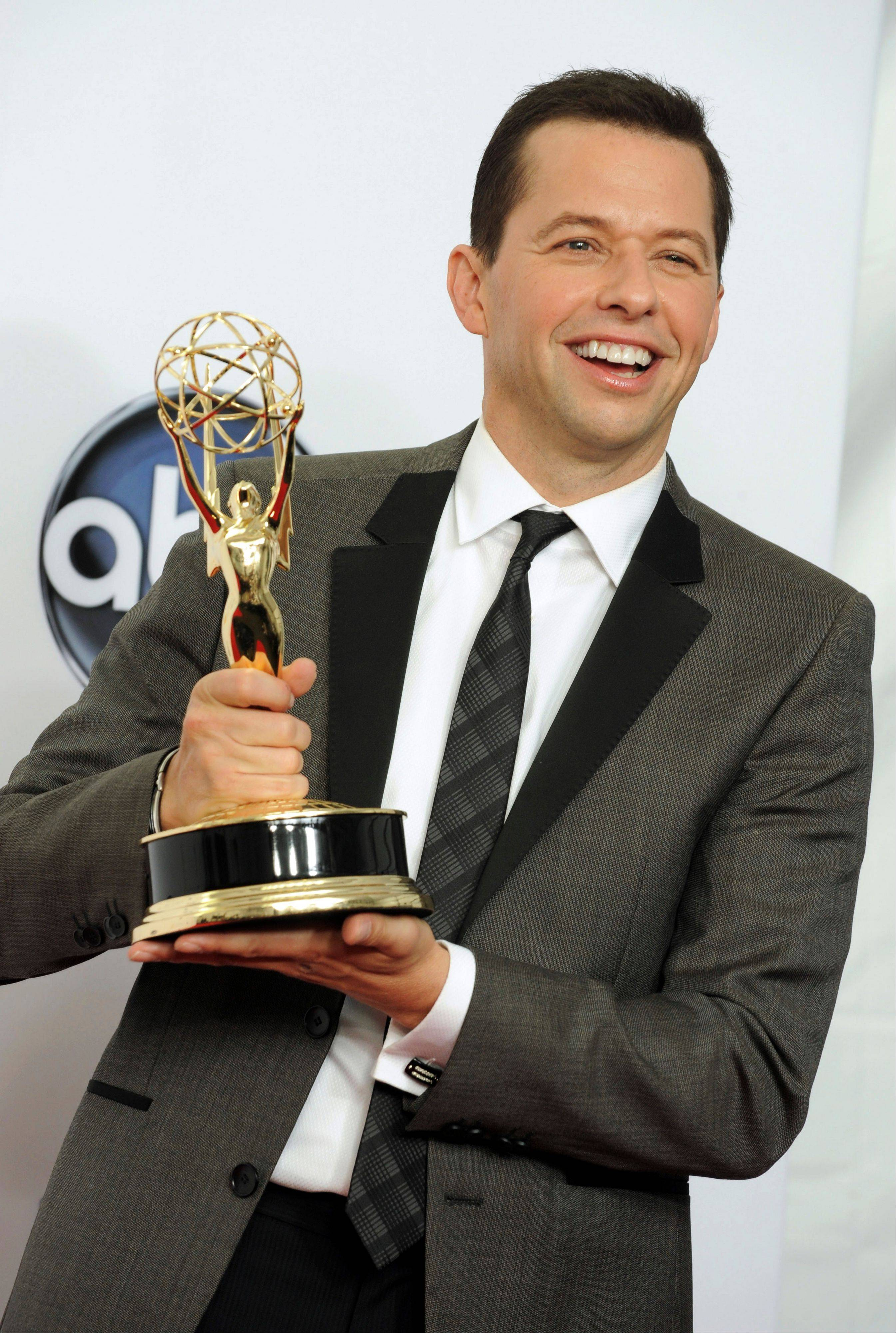 Actor Jon Cryer, winner of Outstanding Lead Actor in a Comedy Series, displays his Emmy backstage at the Nokia Theatre on Sunday in Los Angeles.