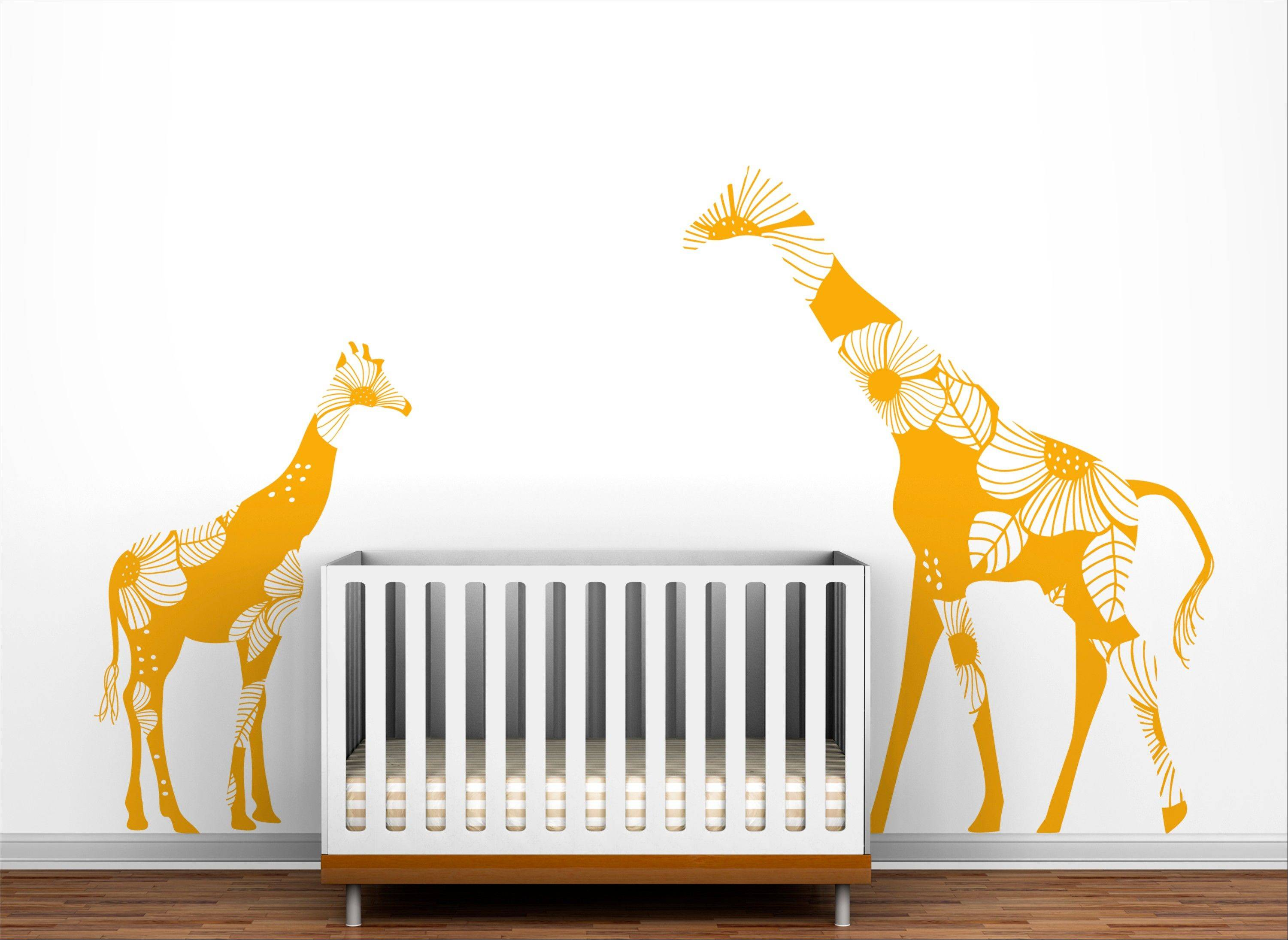A floral giraffe family decal from Toronto-based LittleLion Studio.
