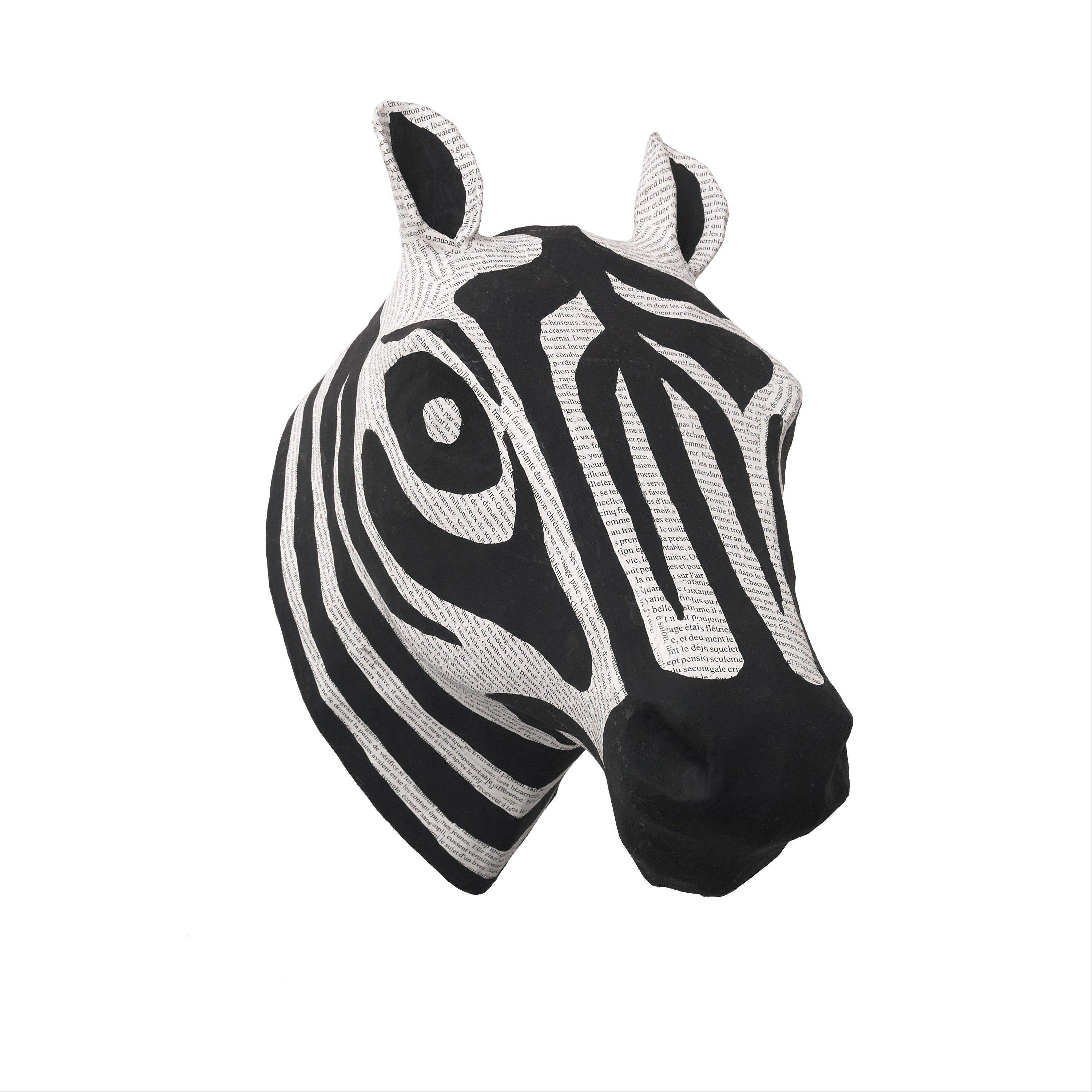 A papier mache zebra head, in black and white, freom Dwell Studio.