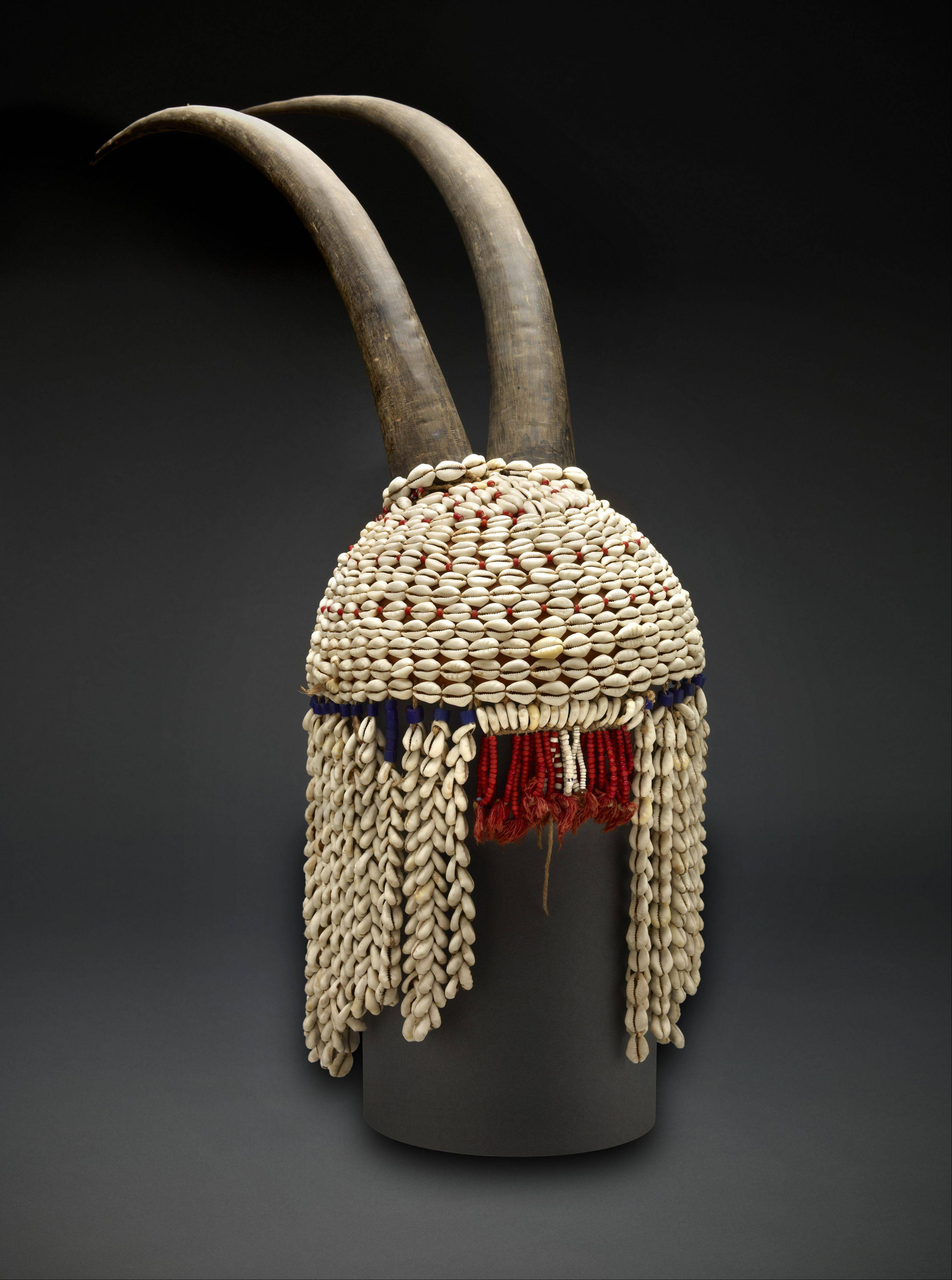 Cowries, the shells of a marine snail, have been valued for thousands of years all over the world. This headdress from Togo combines the smooth beauty of the shells with the horns of an antelope.