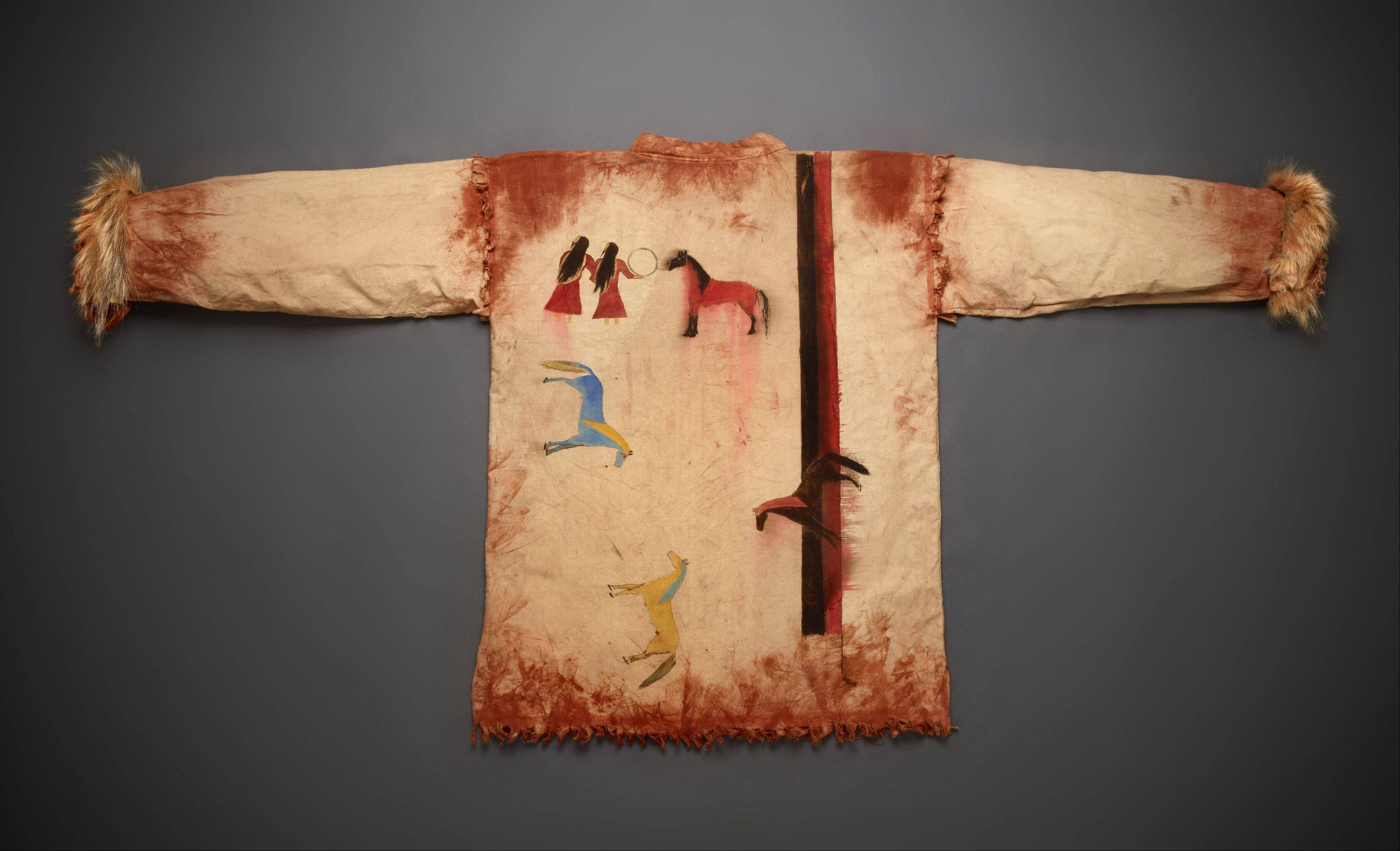 Hand-painted and trimmed in badger fur, this shirt was created by an unknown Sioux artist and was probably worn at Grass Dances.