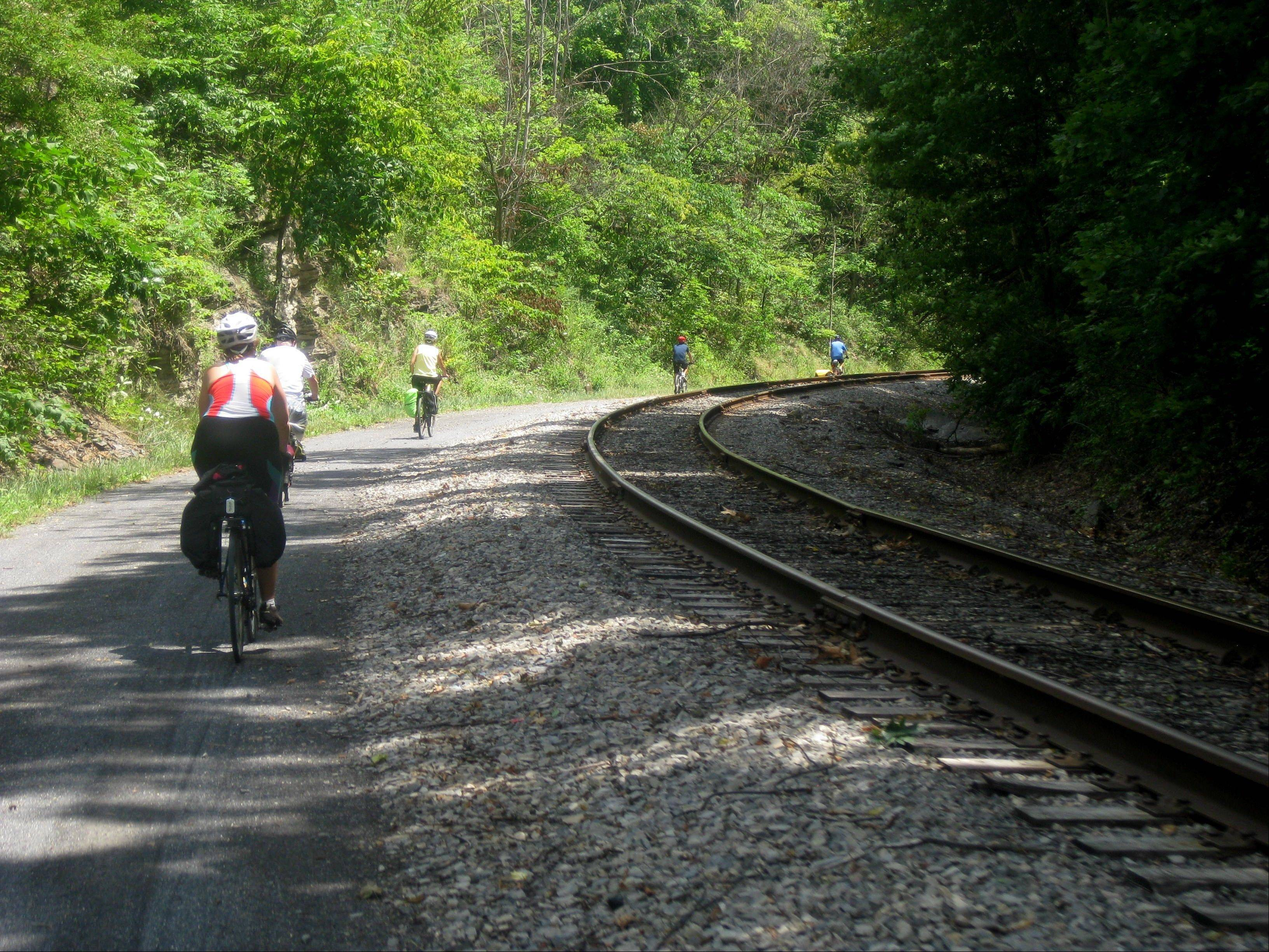 Bicyclists embark on the long descent into Cumberland, Md., in the final leg of a three-day ride on the Great Allegheny Passage.