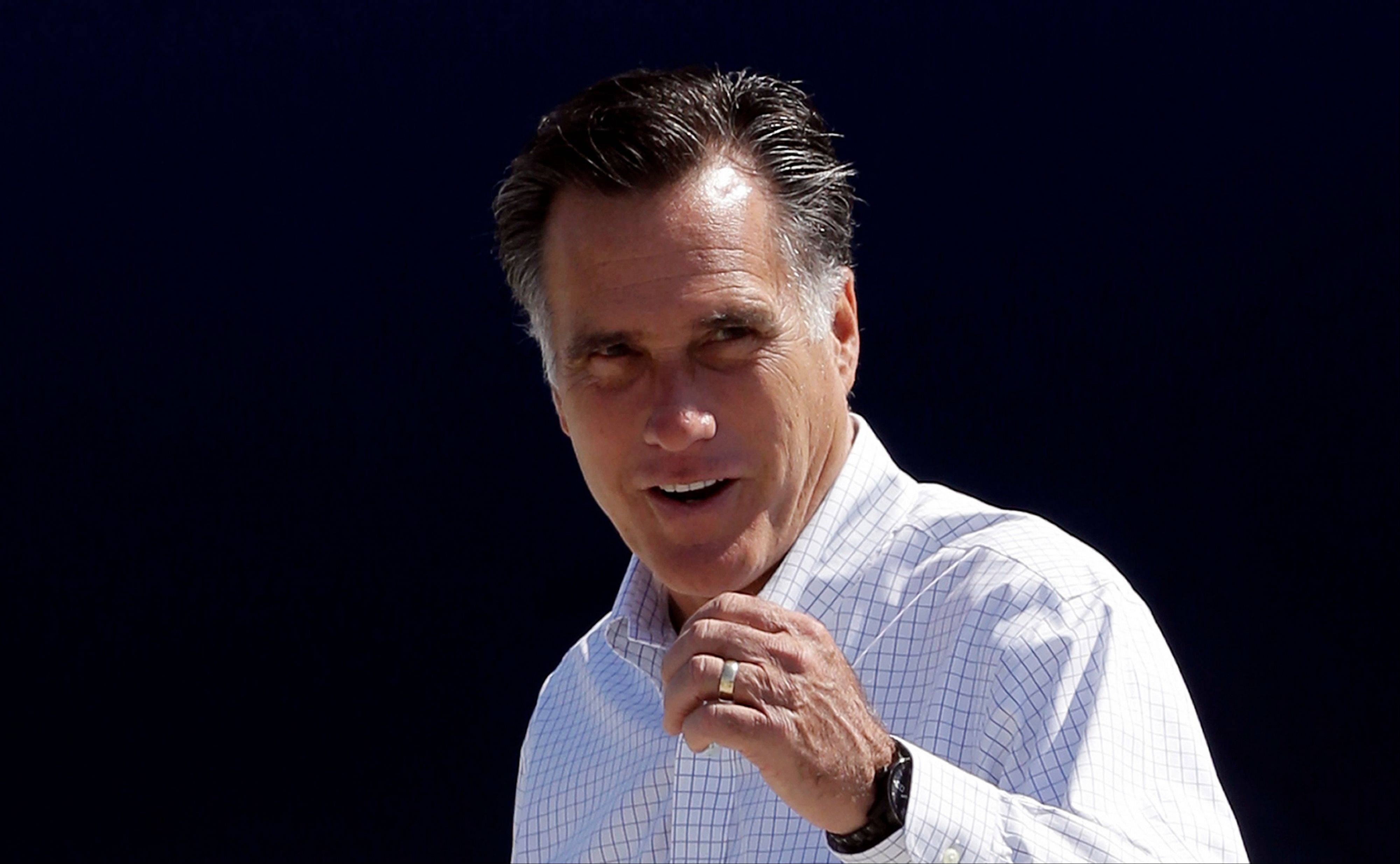 Republican presidential candidate and former Massachusetts Gov. Mitt Romney gets ready to board his campaign plane in Los Angeles, Sunday, Sept. 23, 2012.