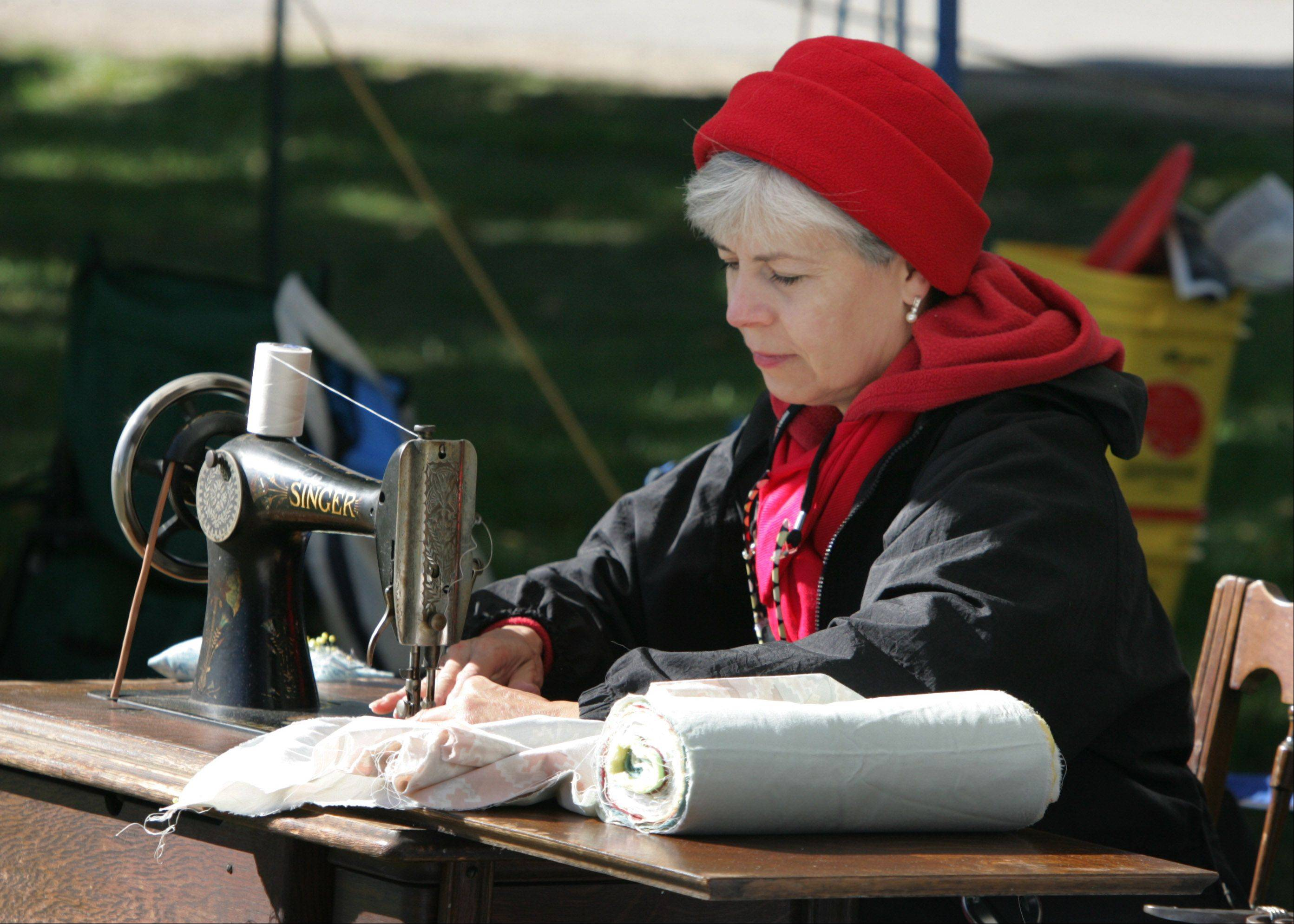 Trudi Handzel, of Palatine, uses a 1905 Singer sewing machine to sew a quilt top during the 20th Annual Farm Heritage Festival Sunday at Lakewood Forest Preserve near Wauconda. The event was co-sponsored by the Lake County Discovery Museum and the Lake County Farm Heritage Association.