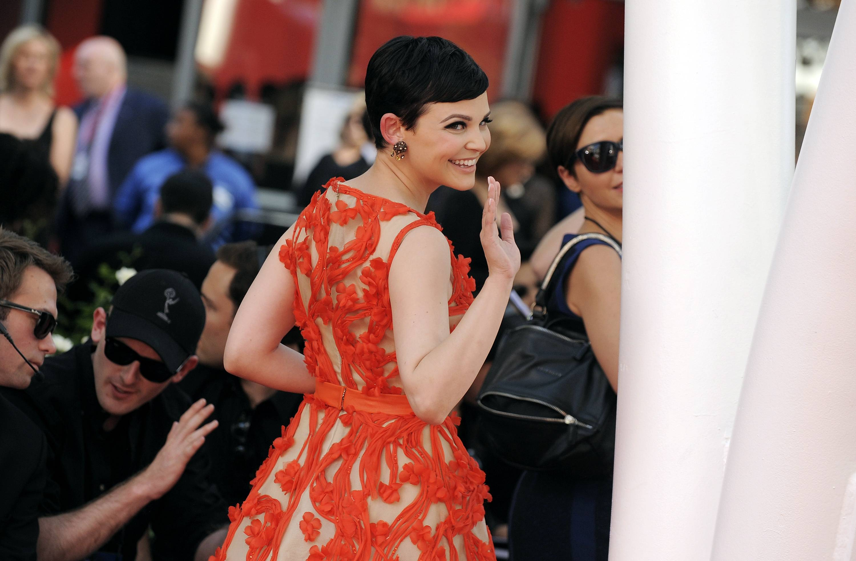 """Once Upon a Time"" actress Ginnifer Goodwin waves to fans before heading into the Emmy Awards."