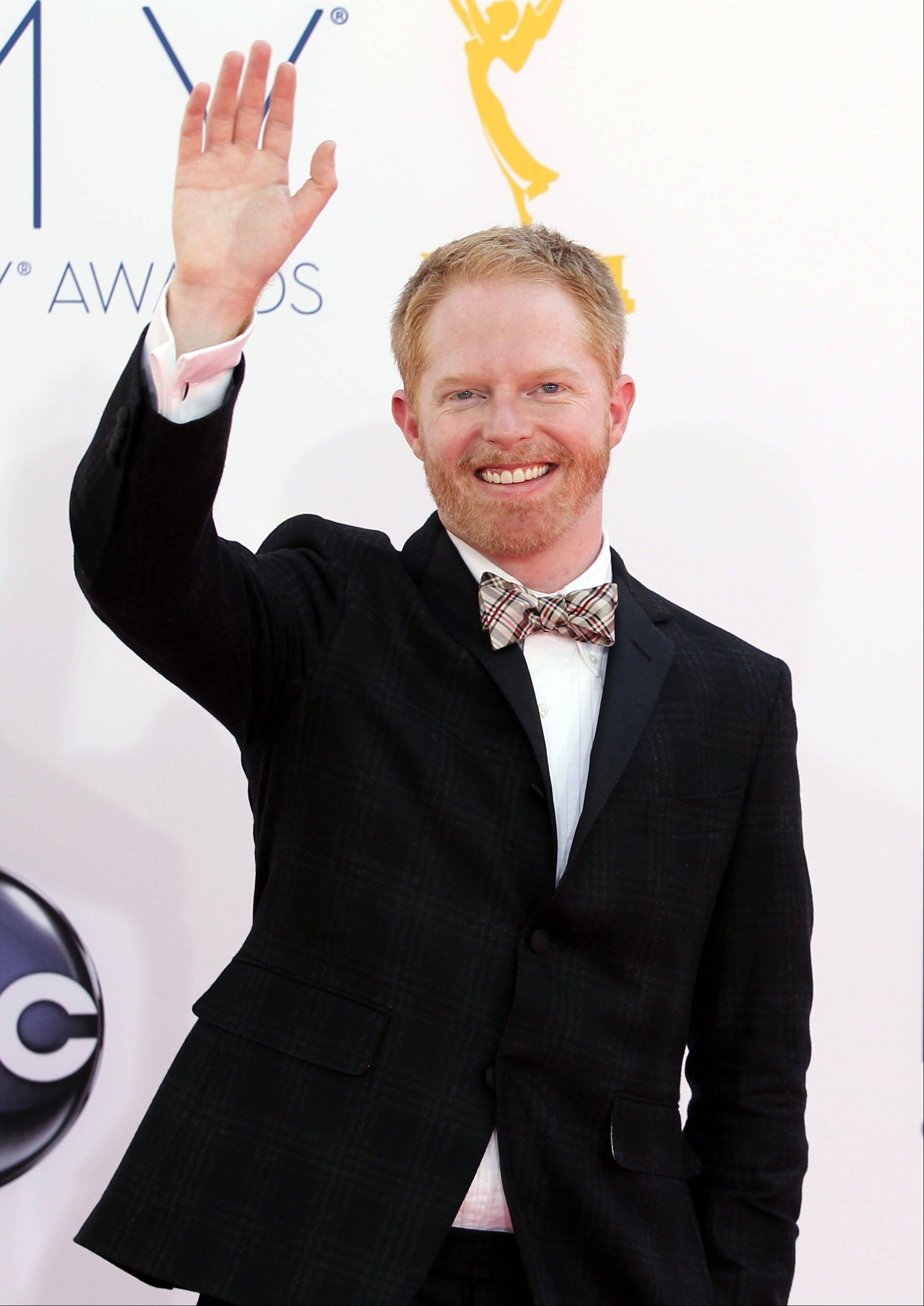 """Modern Family"" star Jesse Tyler Ferguson waves to the crowd outside the theater Sunday night."
