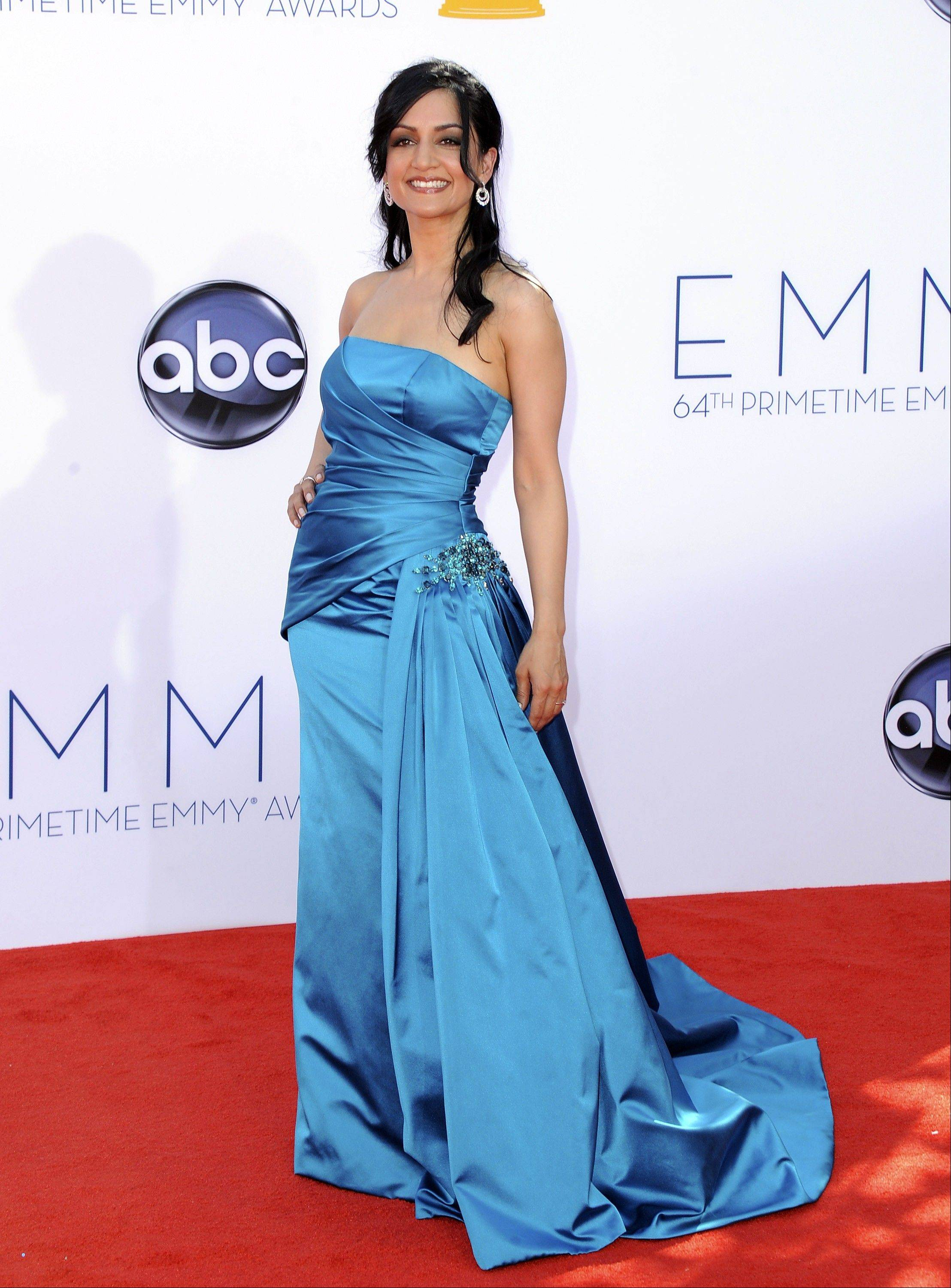 """The Good Wife"" star Archie Panjabi is all smiles in her glamourous blue gown."