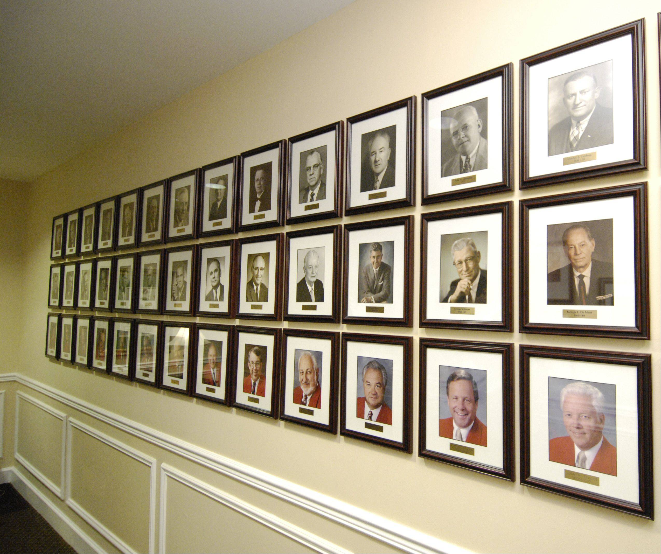 Photographs of Medinah Country Club's past presidents fill the walls of one of the hallways in the clubhouse.
