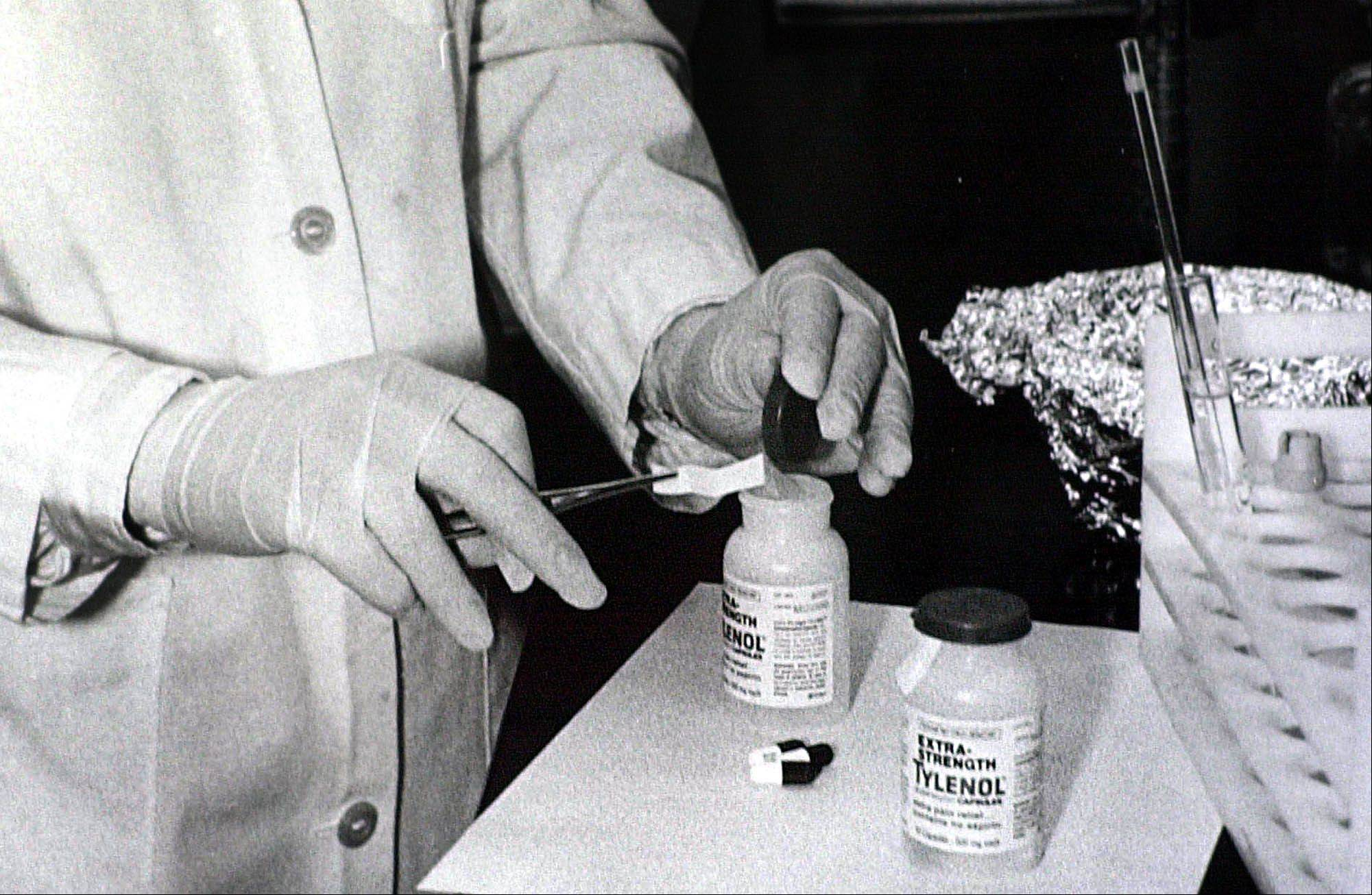 Associated PressBottles of Extra-Strength Tylenol are tested fof cyanide at the Illinois Department of Health in October 1982 in Chicago.