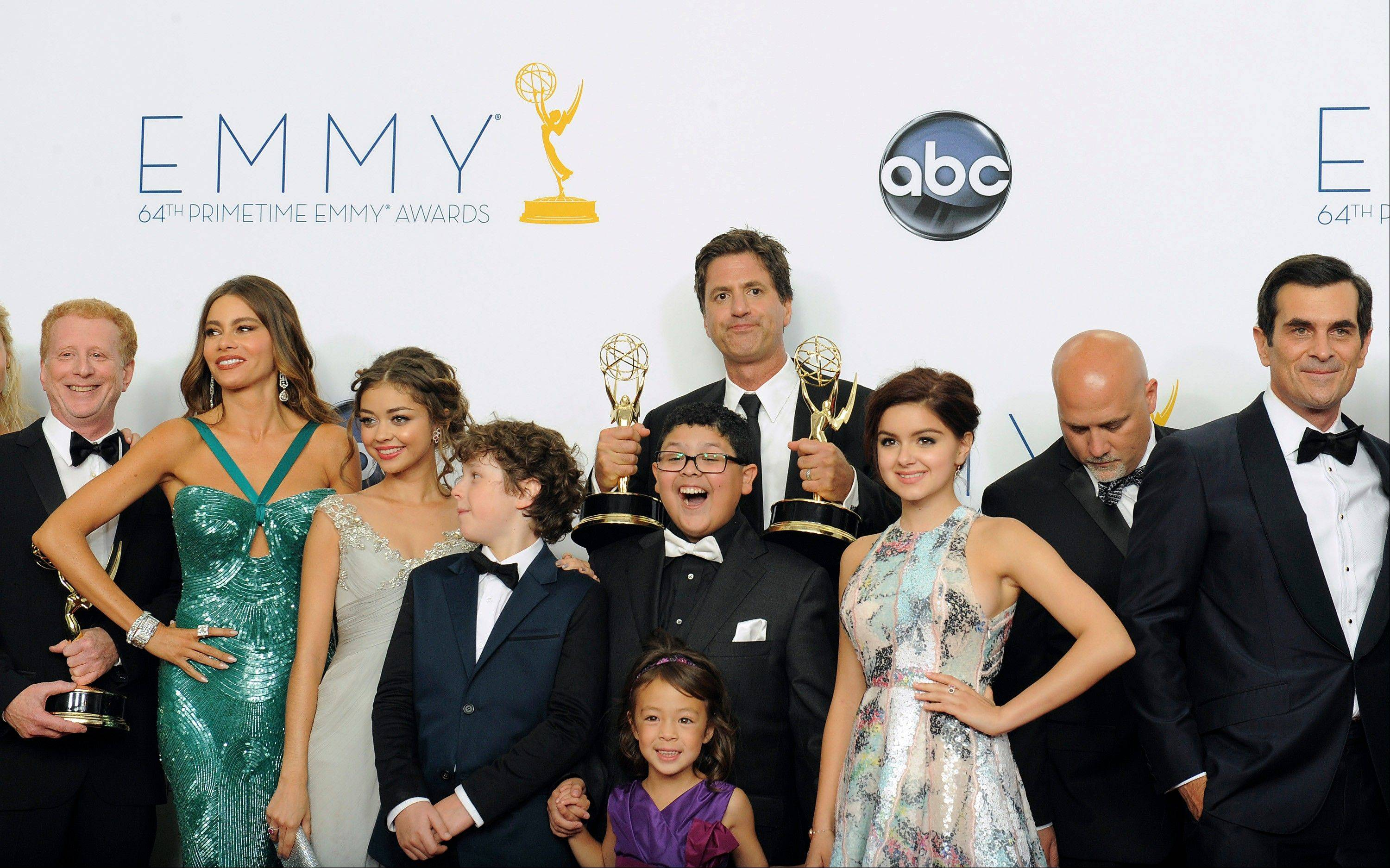"The cast and crew of ""Modern Family,"" winner of the Outstanding Comedy Series award, pose backstage at the 64th Primetime Emmy Awards at the Nokia Theatre on Sunday, Sept. 23, 2012, in Los Angeles."