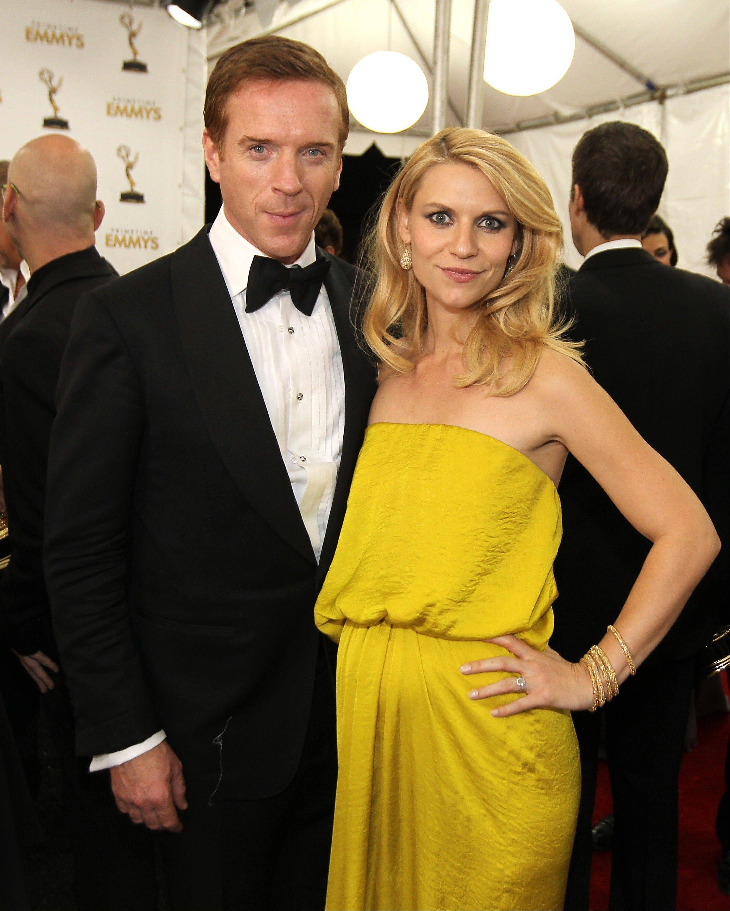 "Actress Claire Danes, winner of the Outstanding Lead Actress In A Drama Series award for ""Homeland,"" right, and actor Damien Lewis, winner of the Outstanding Lead Actor In A Drama Series for ""Homeland,"" pose backstage."