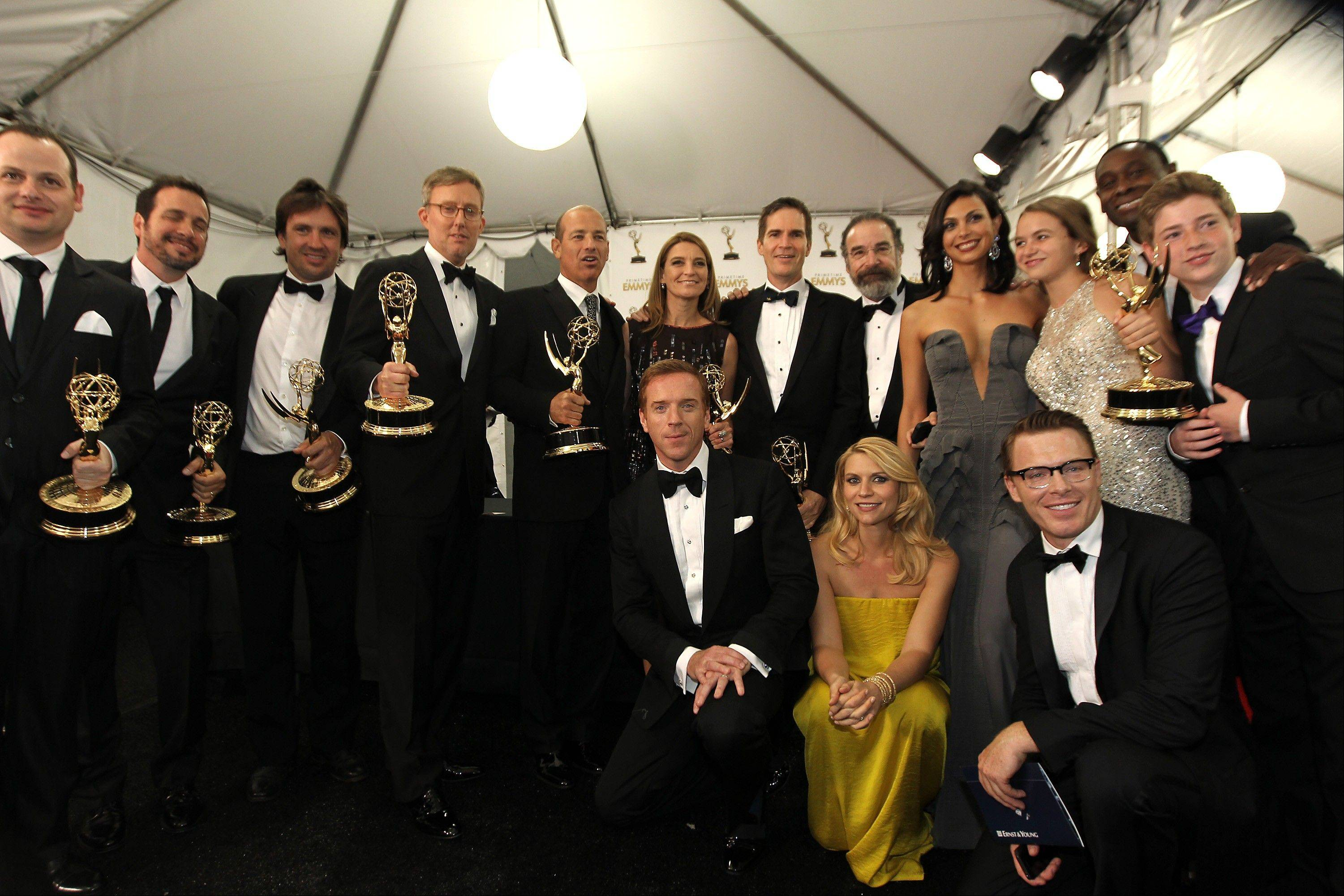 "The cast of ""Homeland"", winner, Outstanding Drama Series pose backstage at the 64th Primetime Emmy Awards at the Nokia Theatre on Sunday, Sept. 23, 2012, in Los Angeles."