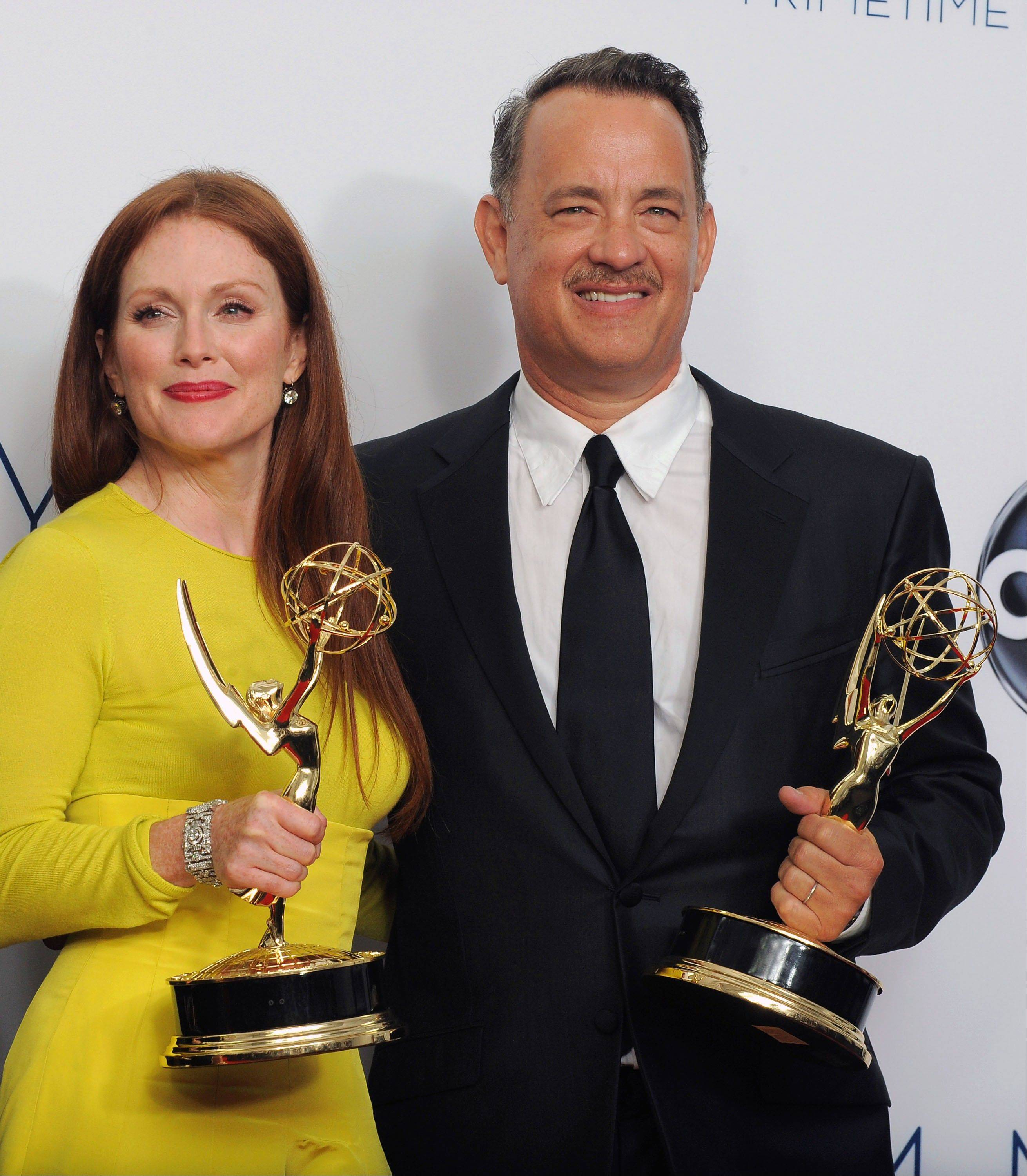 "Actress Julianne Moore, left and producer Tom Hanks winner Outstanding Lead Actress In A Miniseries or Movie for ""Game Change,"" pose backstage."