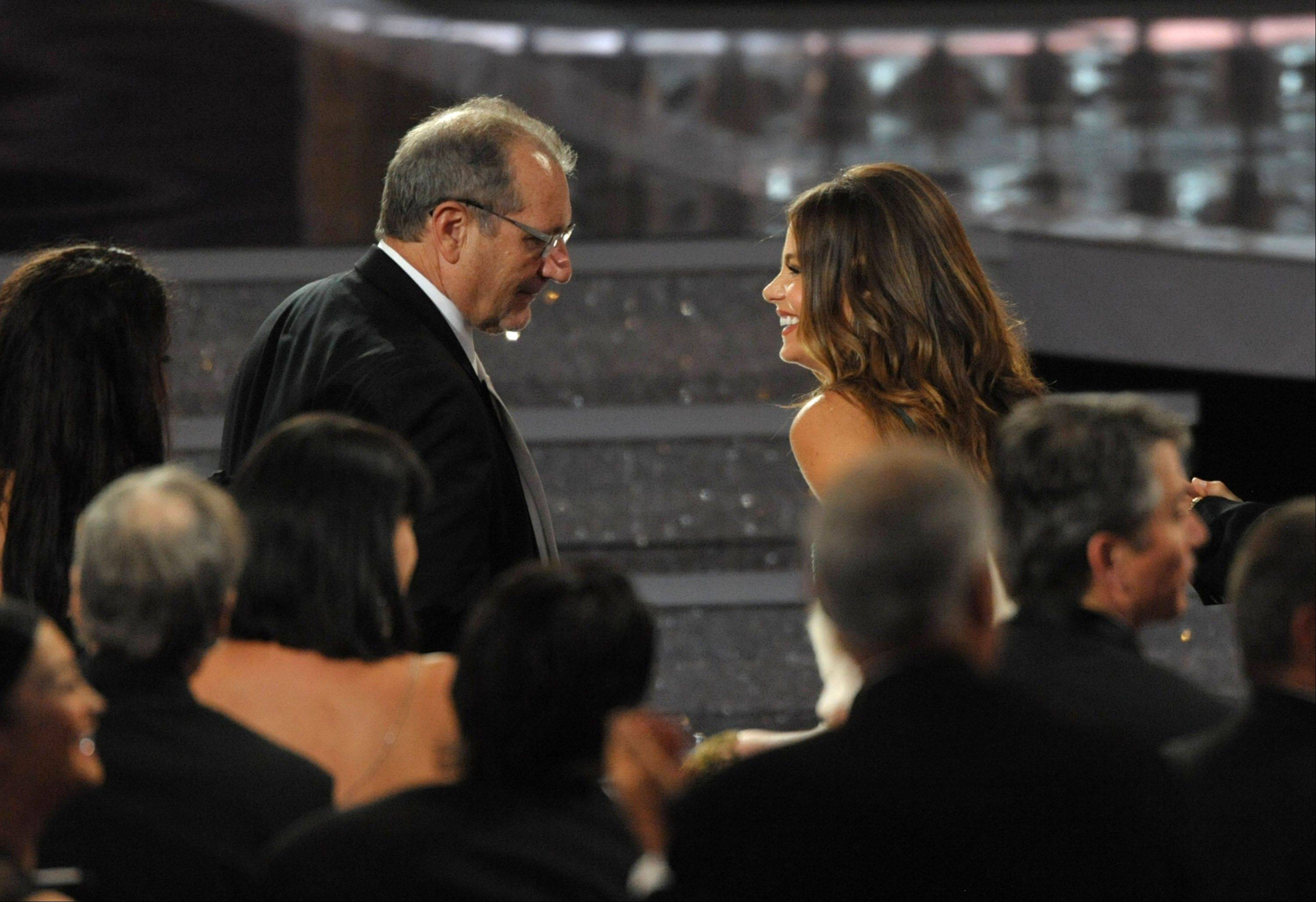 "Ed O'Neill, left, and Sofia Vergara walk onstage to accept the award for outstanding comedy series for ""Modern Family."""