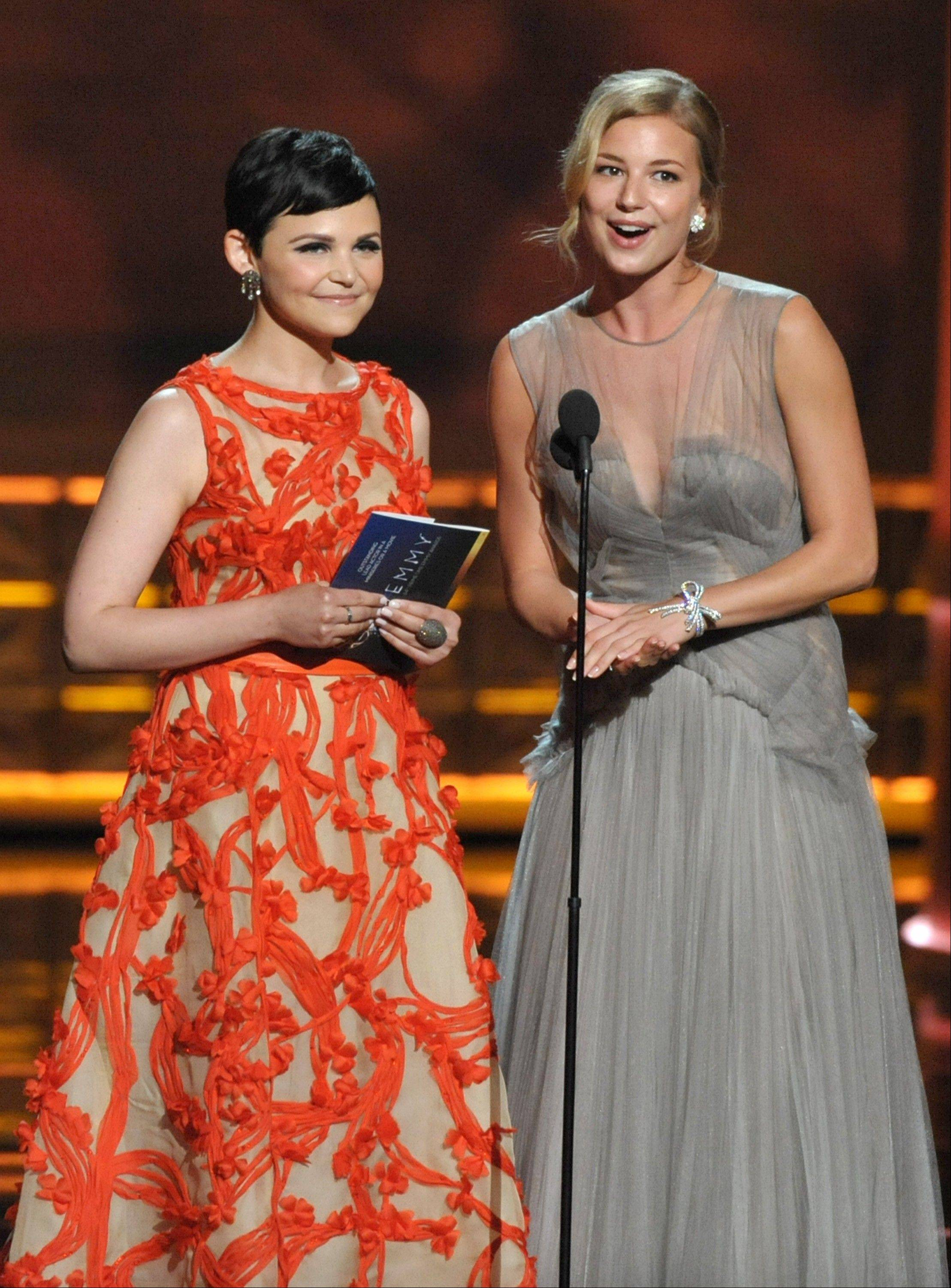 Actress Ginnifer Goodwin, left and actress Emily VanCamp speak onstage at the 64th Primetime Emmy Awards at the Nokia Theatre on Sunday, Sept. 23, 2012, in Los Angeles.