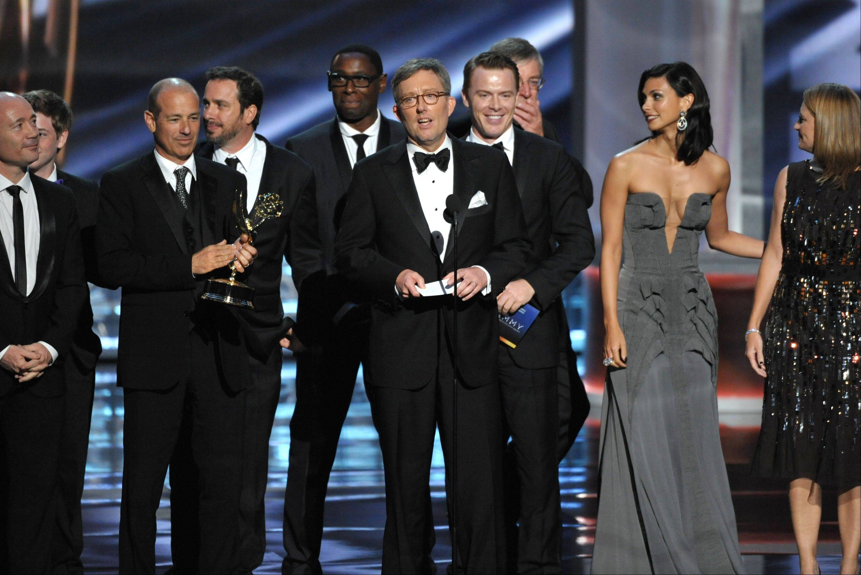 "Alex Gansa, center, and the cast and crew of ""Homeland"" accept the award for outstanding drama series."