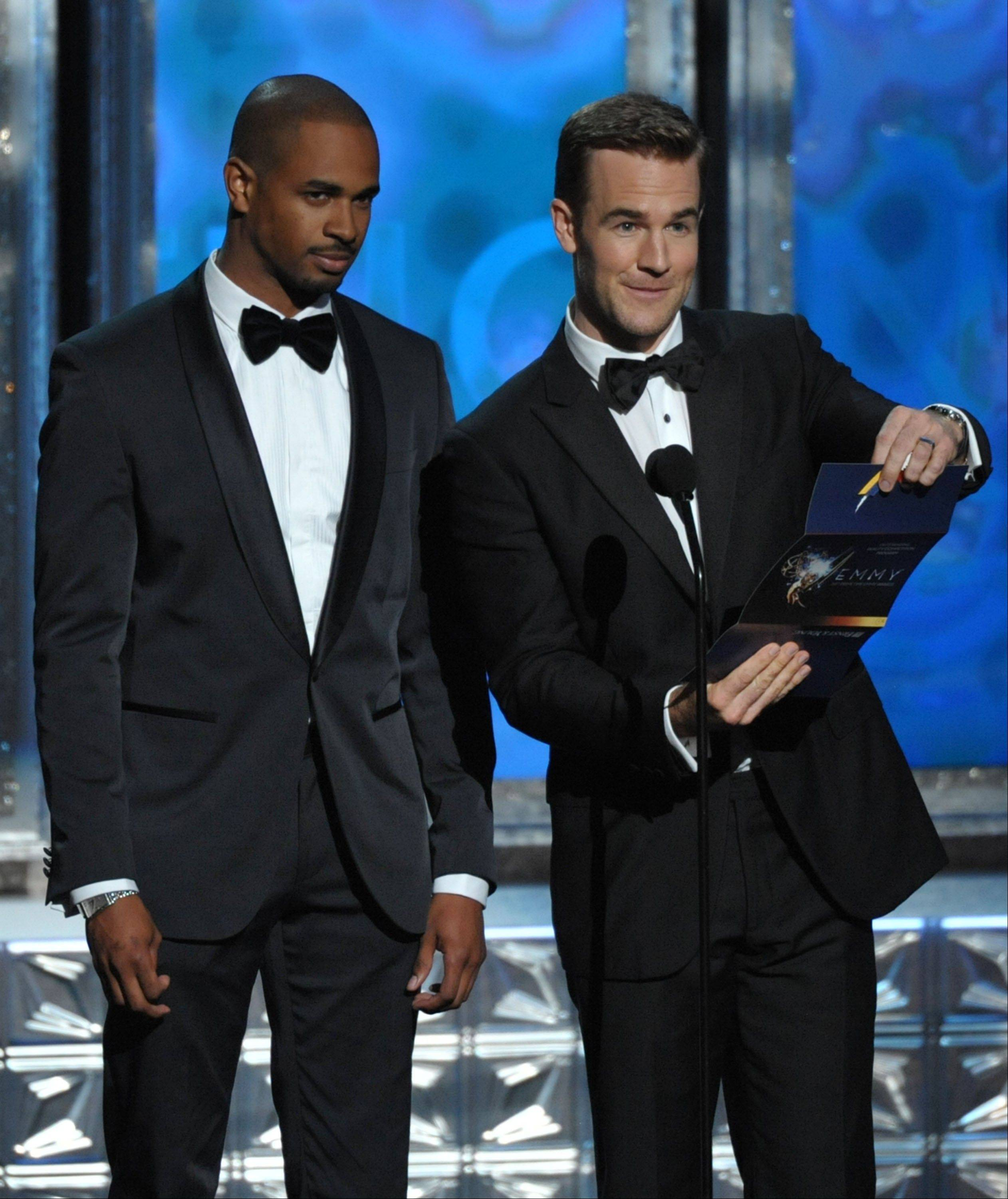 Damon Wayans Jr., left, and James Van Der Beek present an award onstage at the 64th Primetime Emmy Awards at the Nokia Theatre on Sunday, Sept. 23, 2012, in Los Angeles.