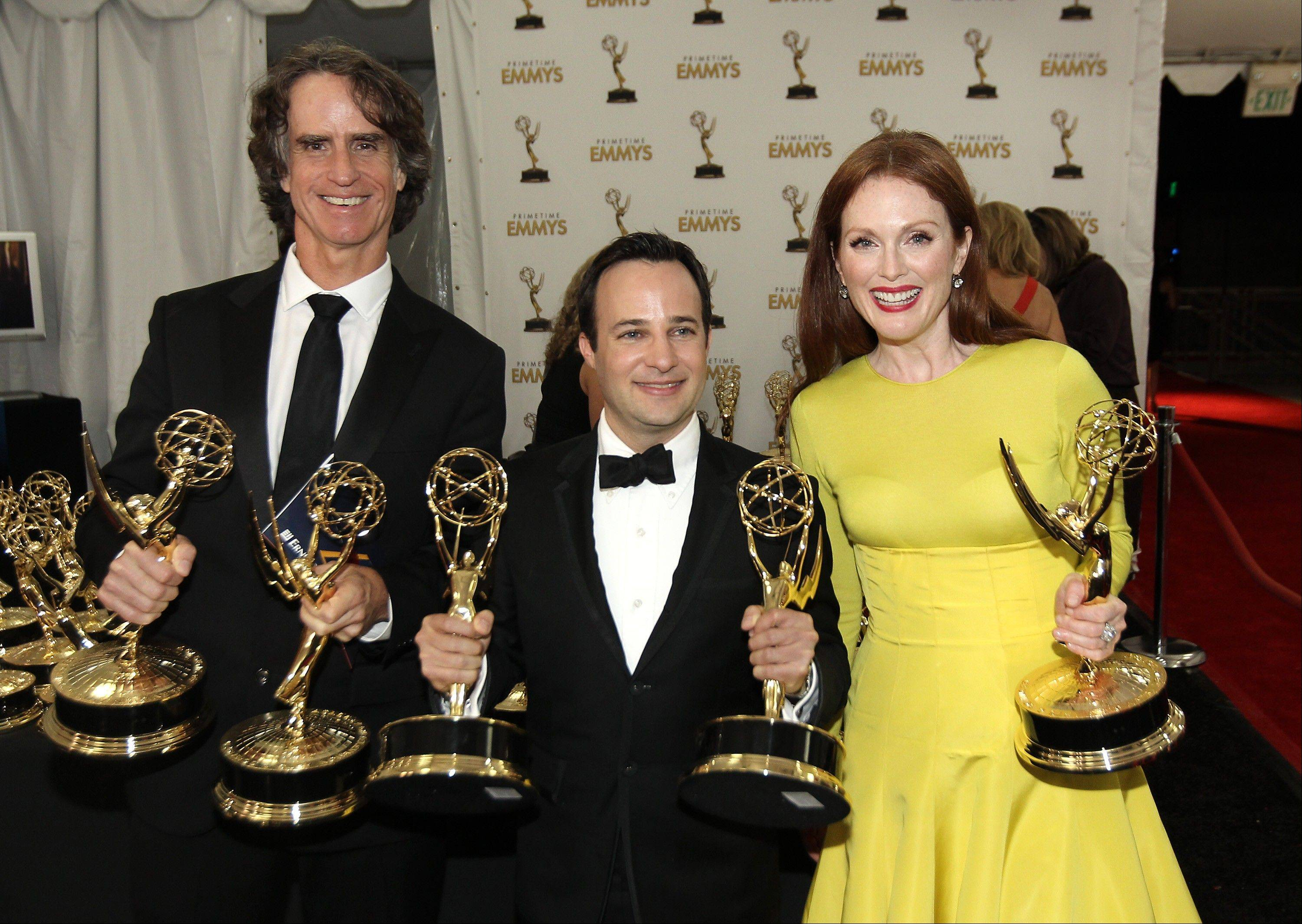 "From left, Director Jay Roach, writer Danny Strong, and Actress Julianne Moore, pose backstage with the awards they won for the HBO movie ""Game Change."""
