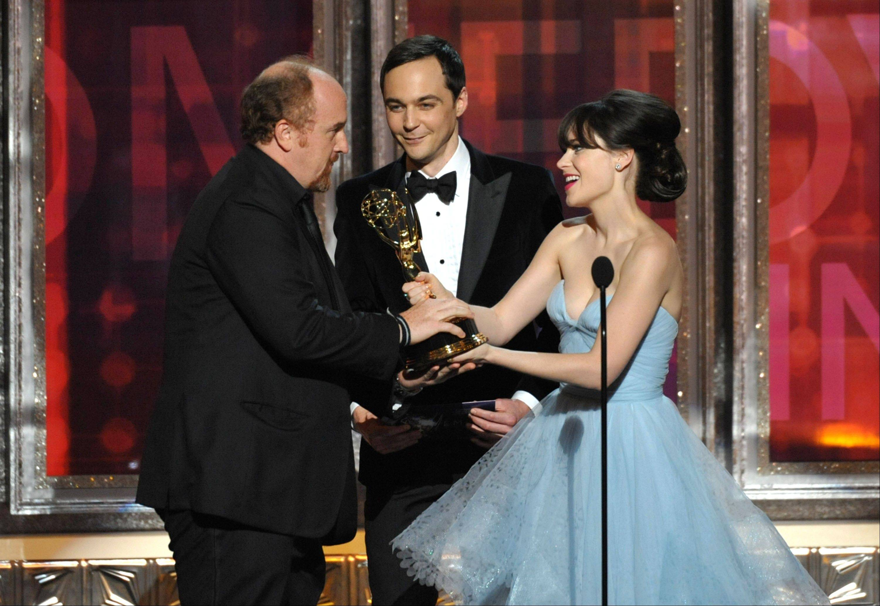 "Adorkable alert! Jim Parsons, center, and Zooey Deschanel, right, present the award for outstanding writing in a comedy series to Louis C.K. for ""Louie."""