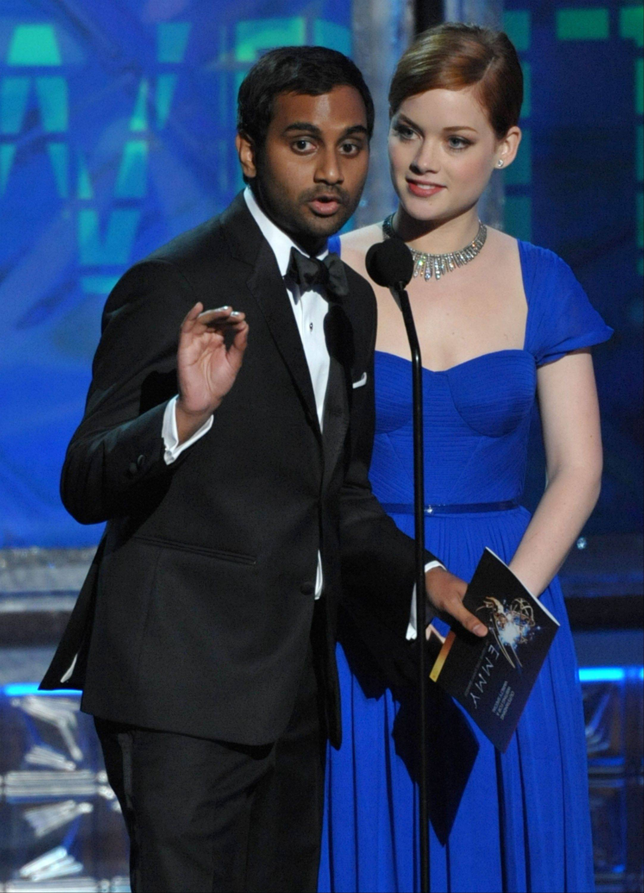 Aziz Ansari, left, and Jane Levy present an award onstage at the 64th Primetime Emmy Awards at the Nokia Theatre on Sunday, Sept. 23, 2012, in Los Angeles.