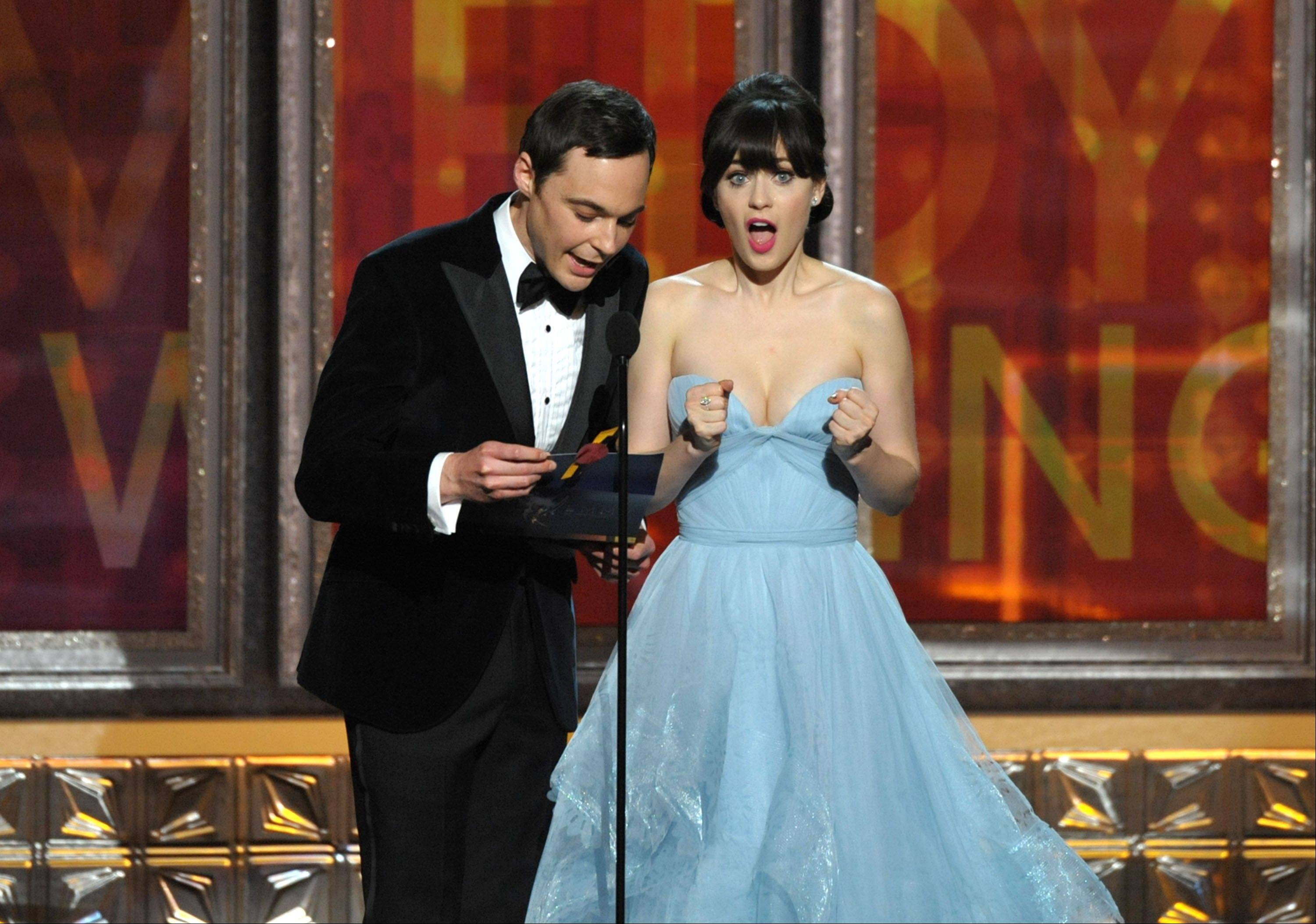 Jim Parsons, left, and Zooey Deschanel get a little excited while presenting an award.