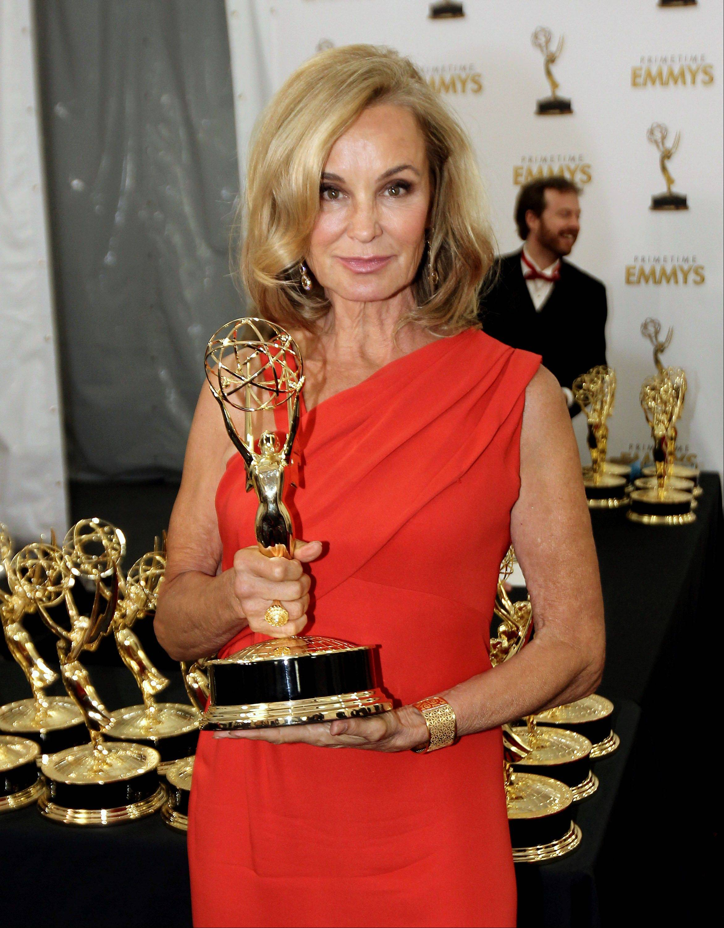 "Actress Jessica Lange, winner of outstanding supporting actress in a miniseries or a movie for ""American Horror Story,"" poses with her Emmy."