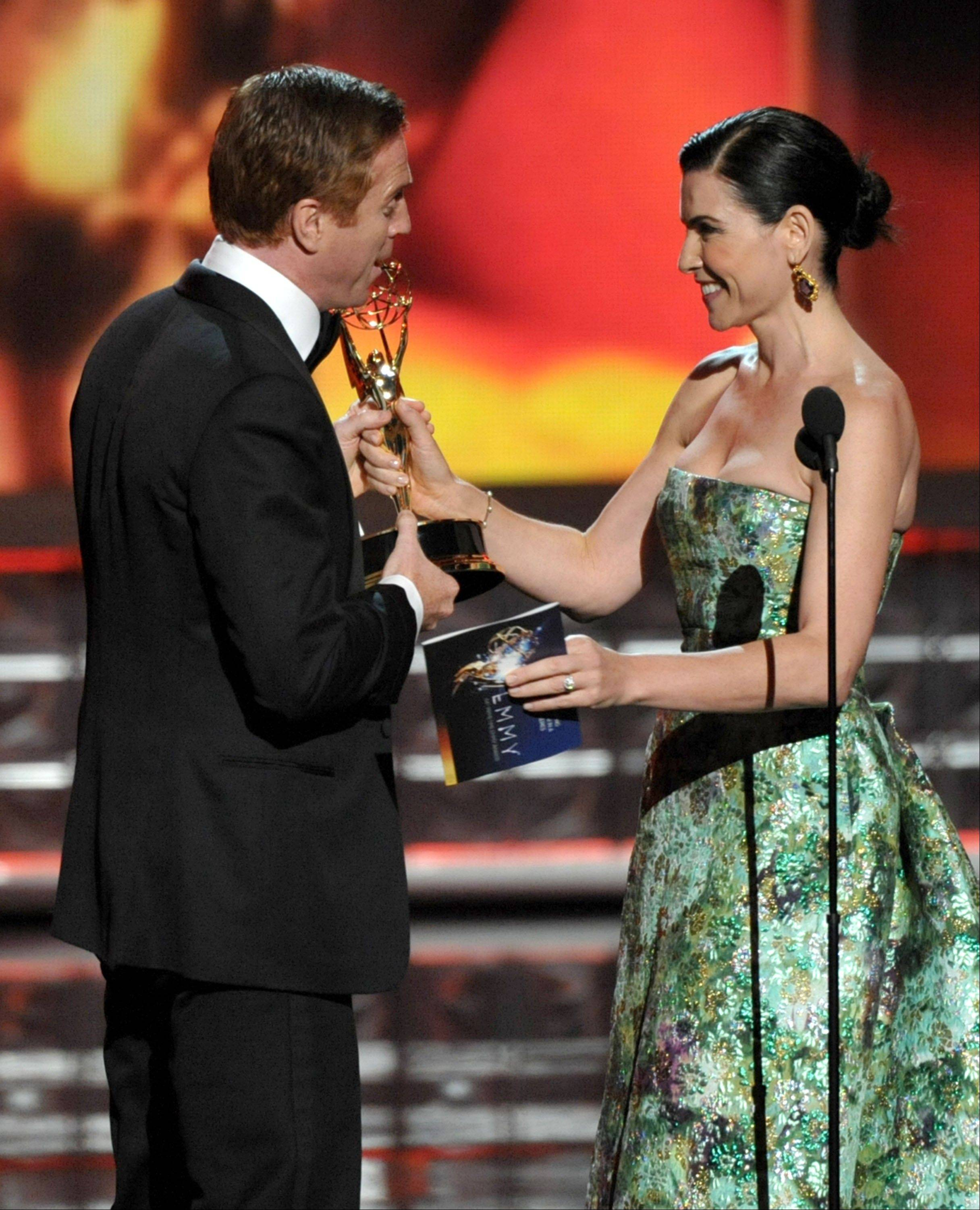 """The Good Wife"" star Julianna Margulies, right, presents the award for outstanding lead actor in a drama series to Damian Lewis for ""Homeland."""