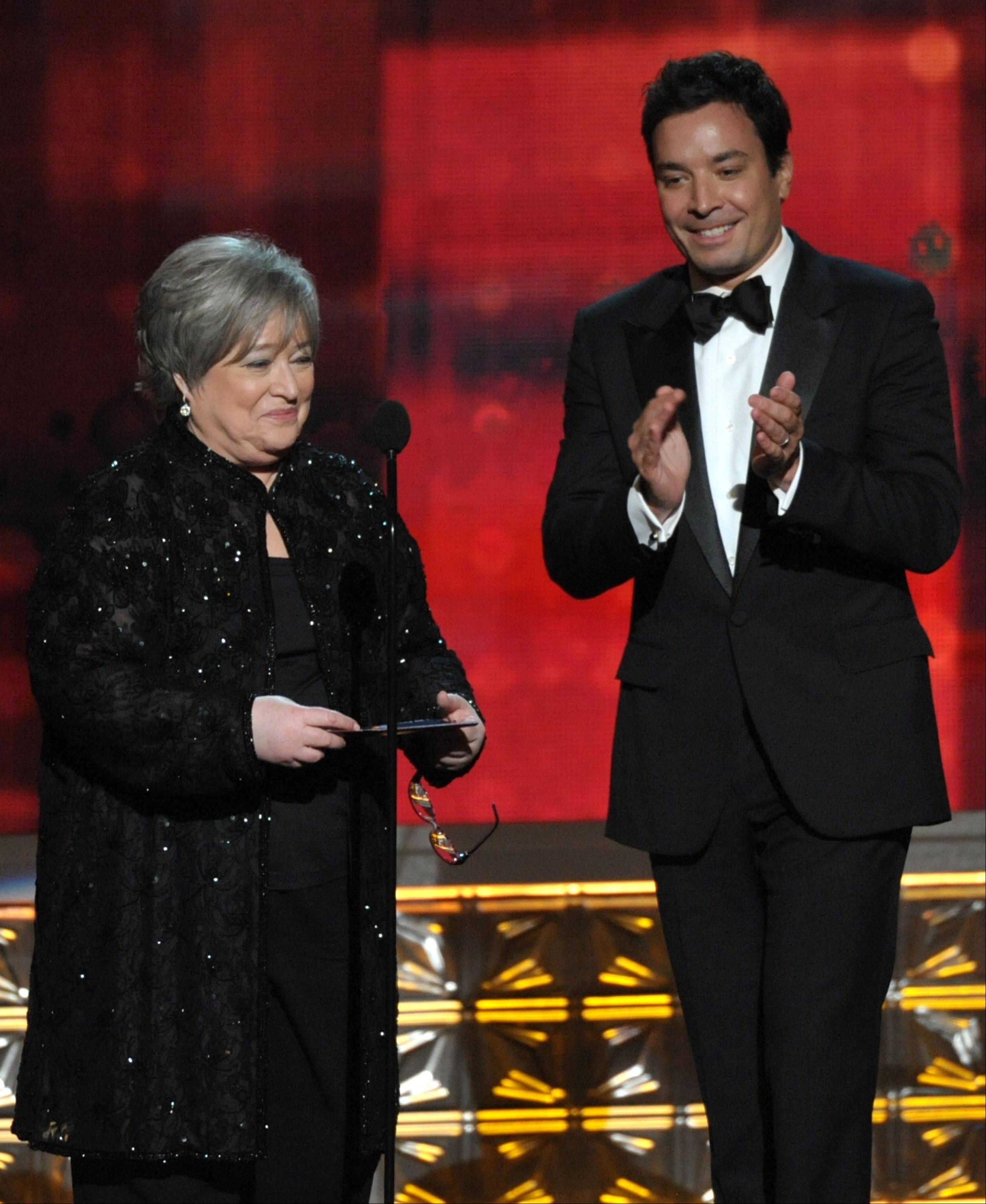 An ailing Kathy Bates, left, and Jimmy Fallon present an award onstage at the 64th Primetime Emmy Awards.