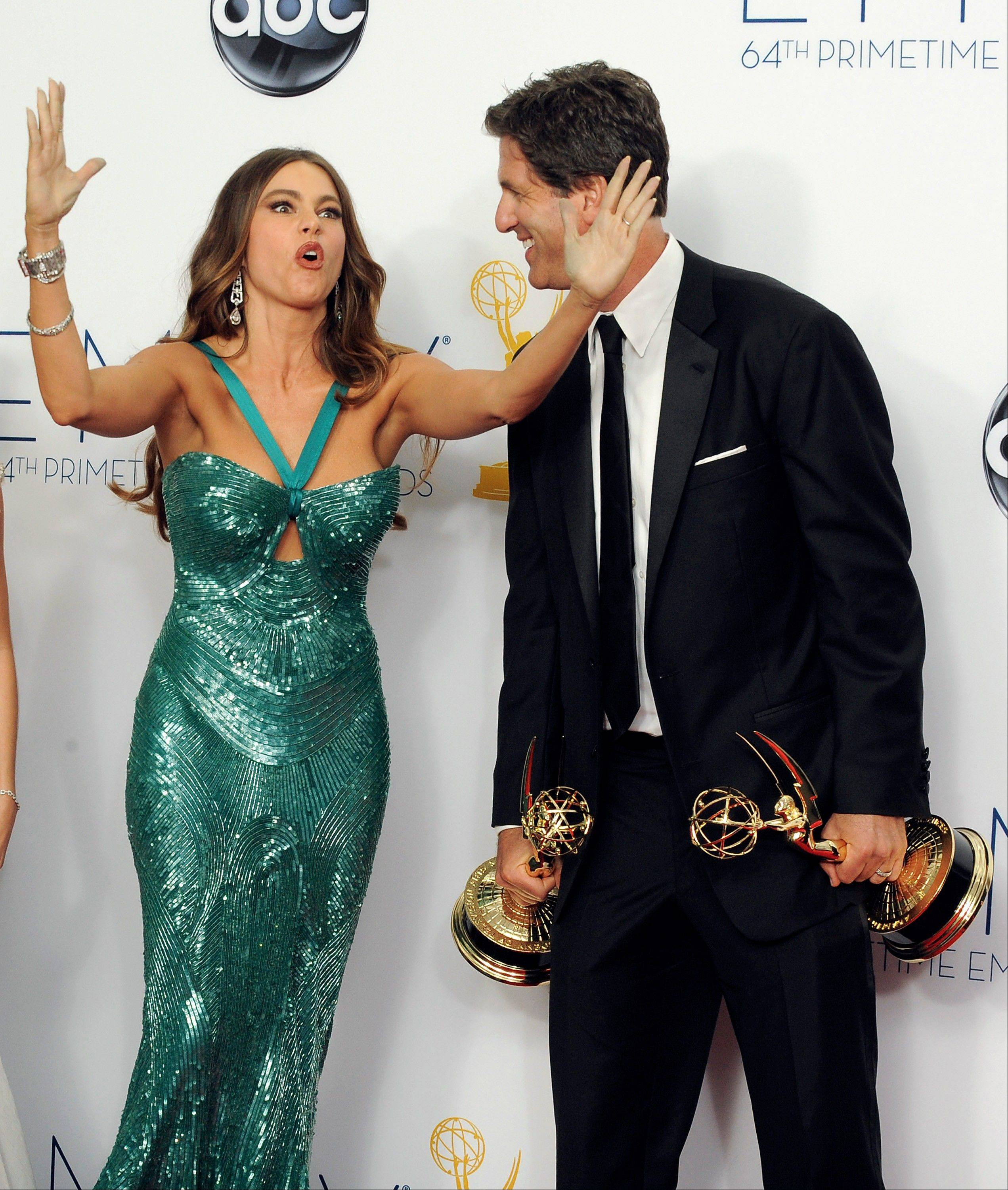 "Actress Sofia Vergara, left and director Steven Levitan, winner of the Outstanding Directing for a Comedy Series award for ""Modern Family,"" have a little fun backstage."