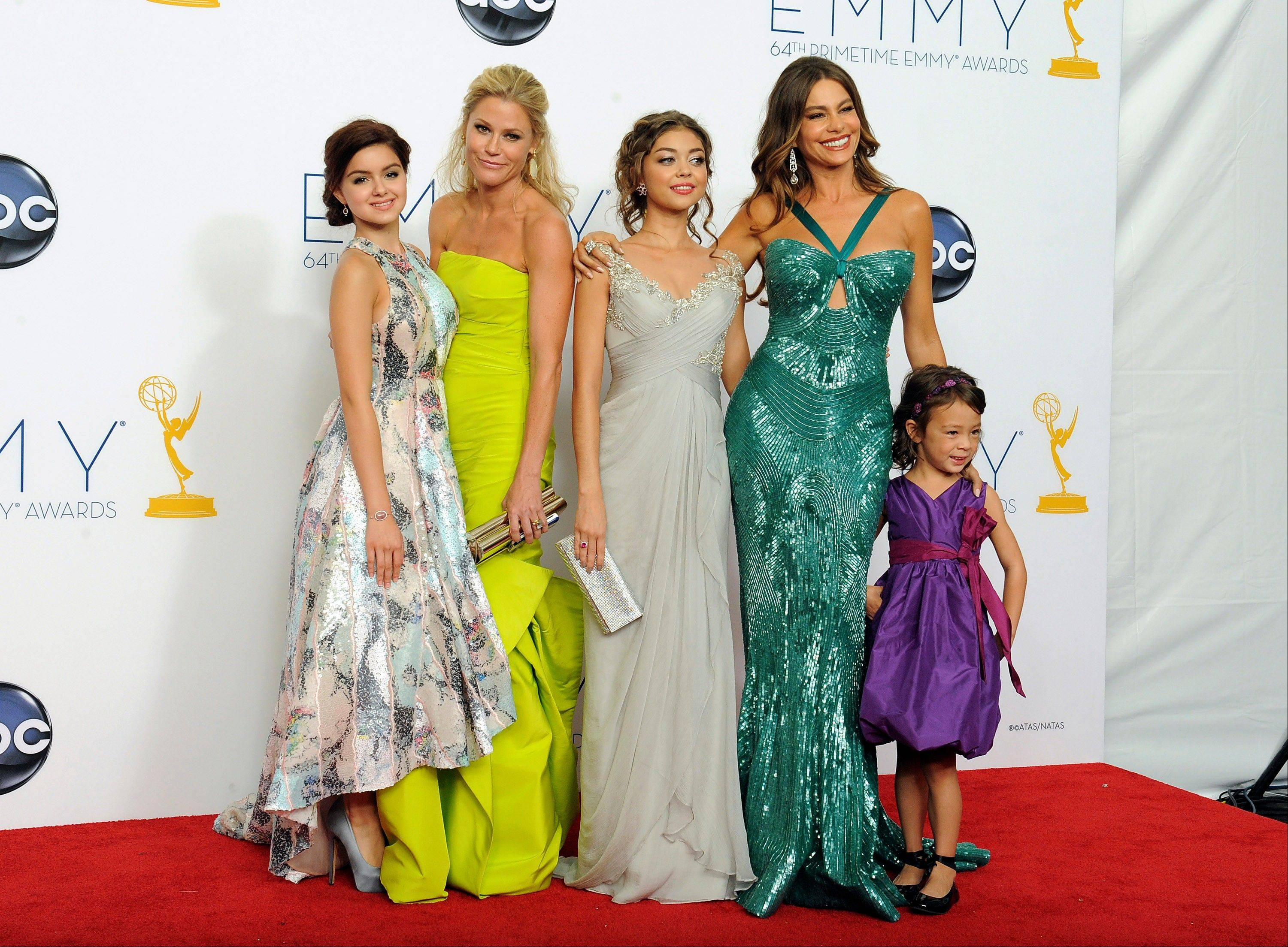 "From left, actresses Ariel Winter, Julie Bowen, Sarah Hyland, Sofia Vergara, and Aubrey Anderson-Emmons, from the Outstanding Comedy Series award-winning series ""Modern Family,"" pose backstage."