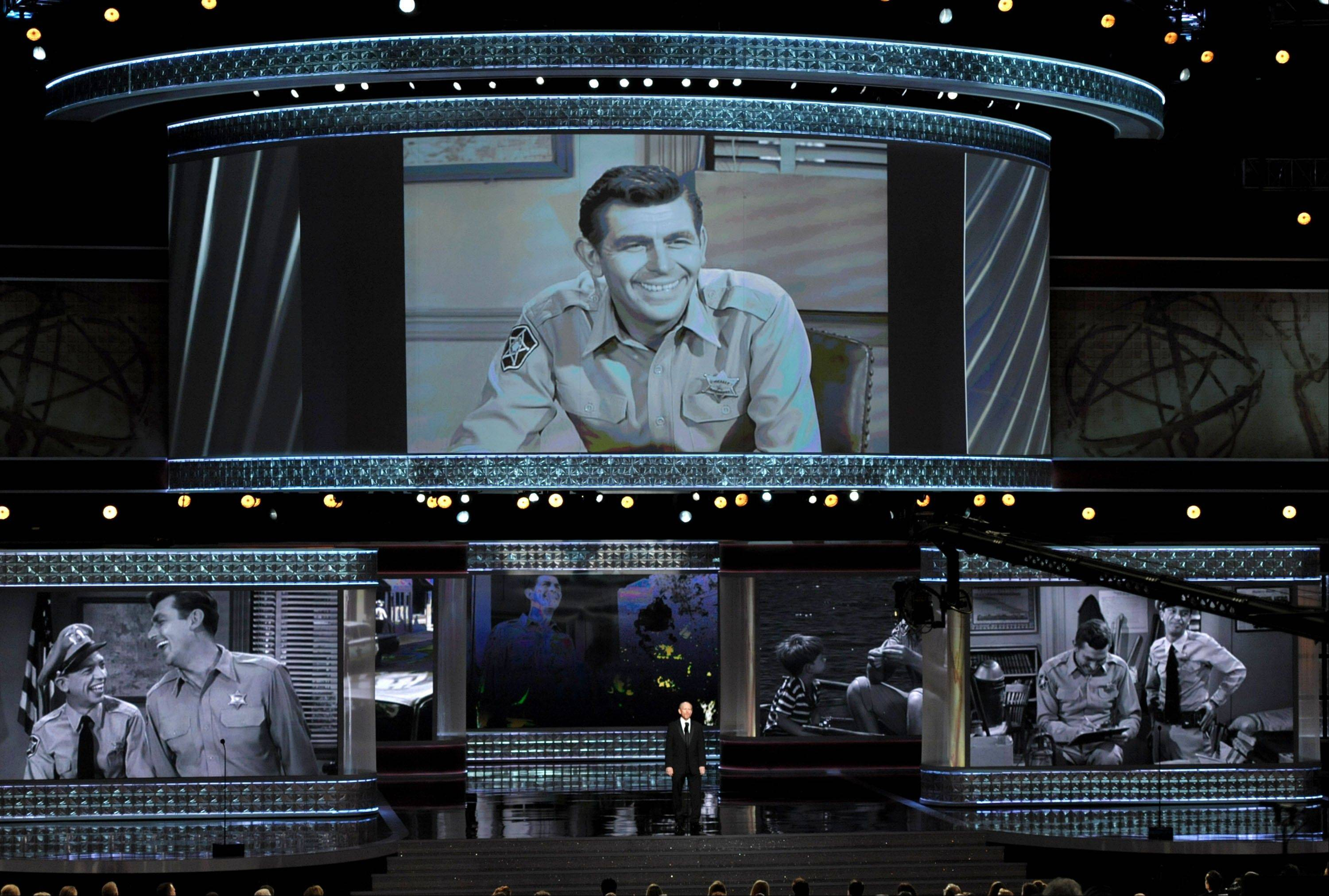 "Ron Howard presents an ""In Memorial"" at the 64th Primetime Emmy Awards at the Nokia Theatre on Sunday, Sept. 23, 2012, in Los Angeles. Pictured onscreen is Andy Griffith."