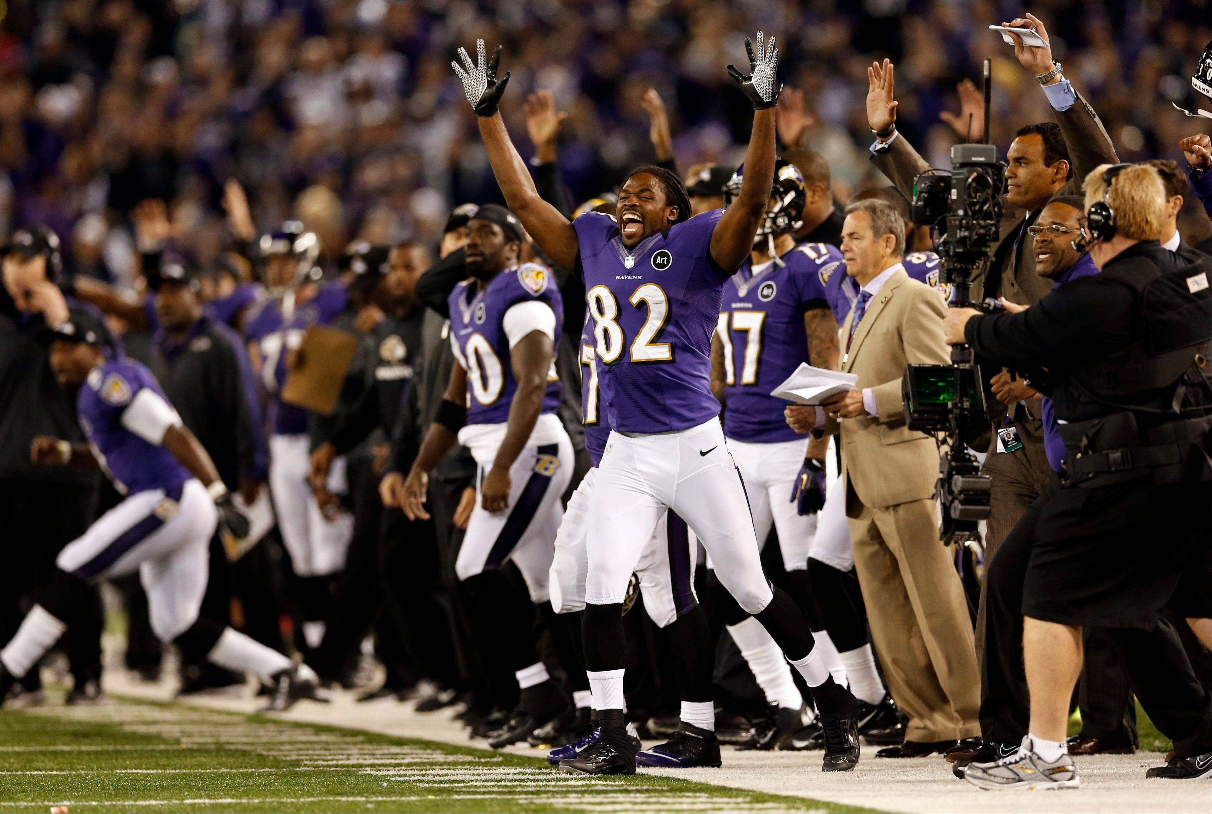 Ravens wide receiver Torrey Smith celebrates after kicker Justin Tucker's game-winning field goal Sunday night against the New England Patriots in Baltimore.