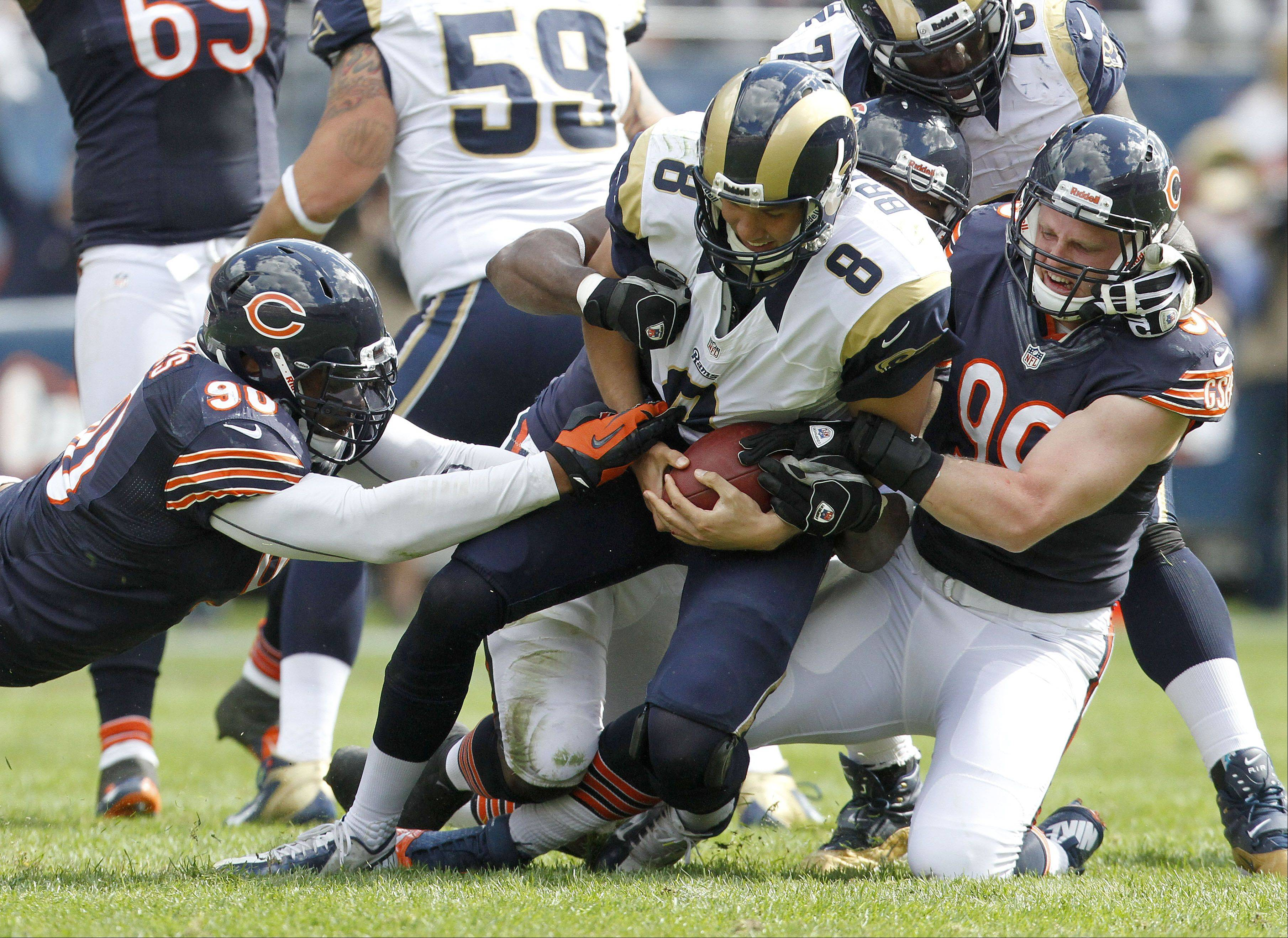 Bears defensive end Julius Peppers and defensive end Shea McClellin sack St. Louis Rams quarterback Sam Bradford during the Bears 23-6 win over the St. Louis Rams Sunday at Soldier Field in Chicago.