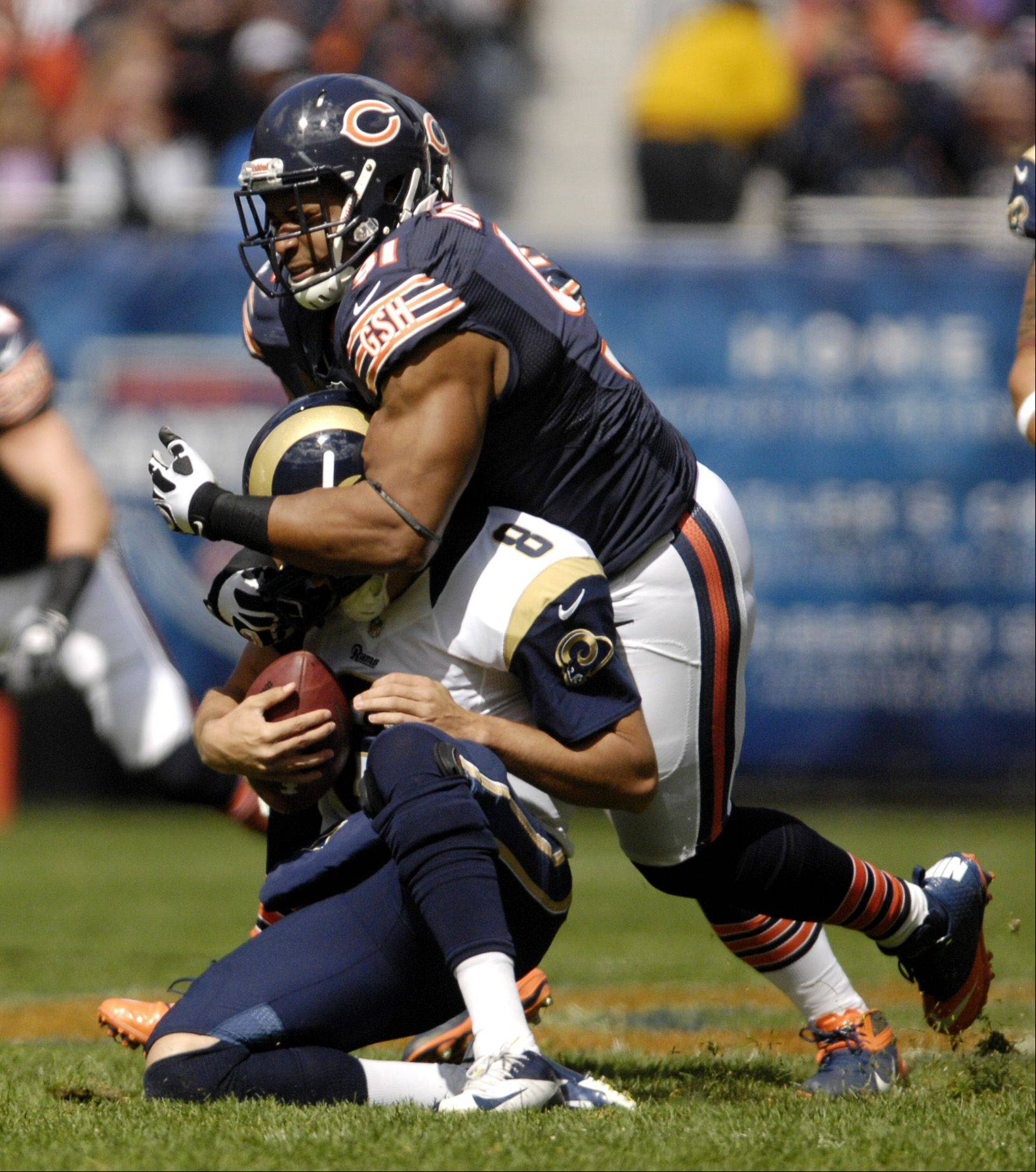 Bears defensive tackle Amobi Okoye (91) sacks St. Louis Rams quarterback Sam Bradford (8) during the first quarter at Soldier Field in Chicago.