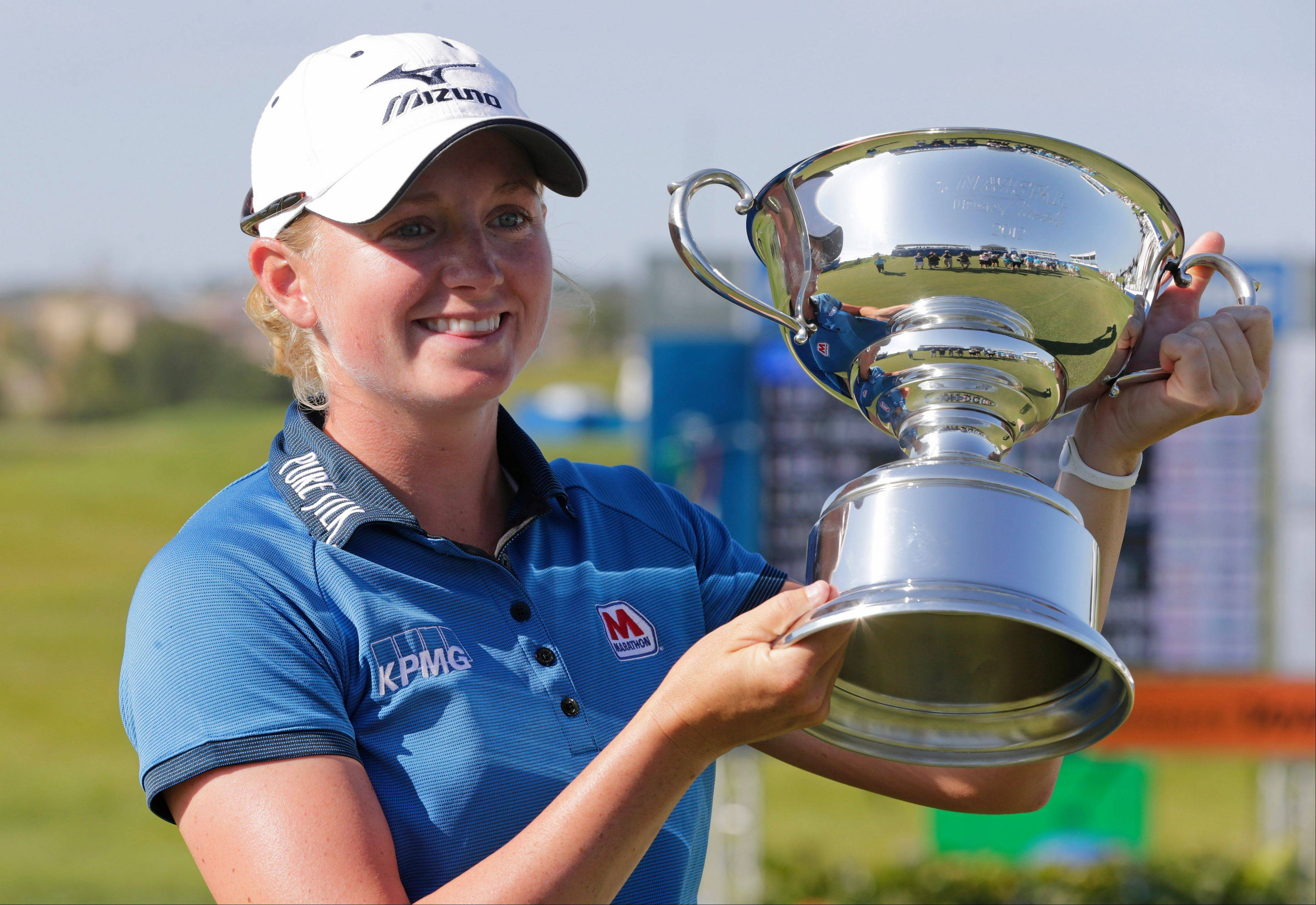Stacy Lewis displays the trophy after winning the Navistar LPGA Classic golf tournament on Sunday at the Robert Trent Jones Golf Trail in Prattville, Ala.