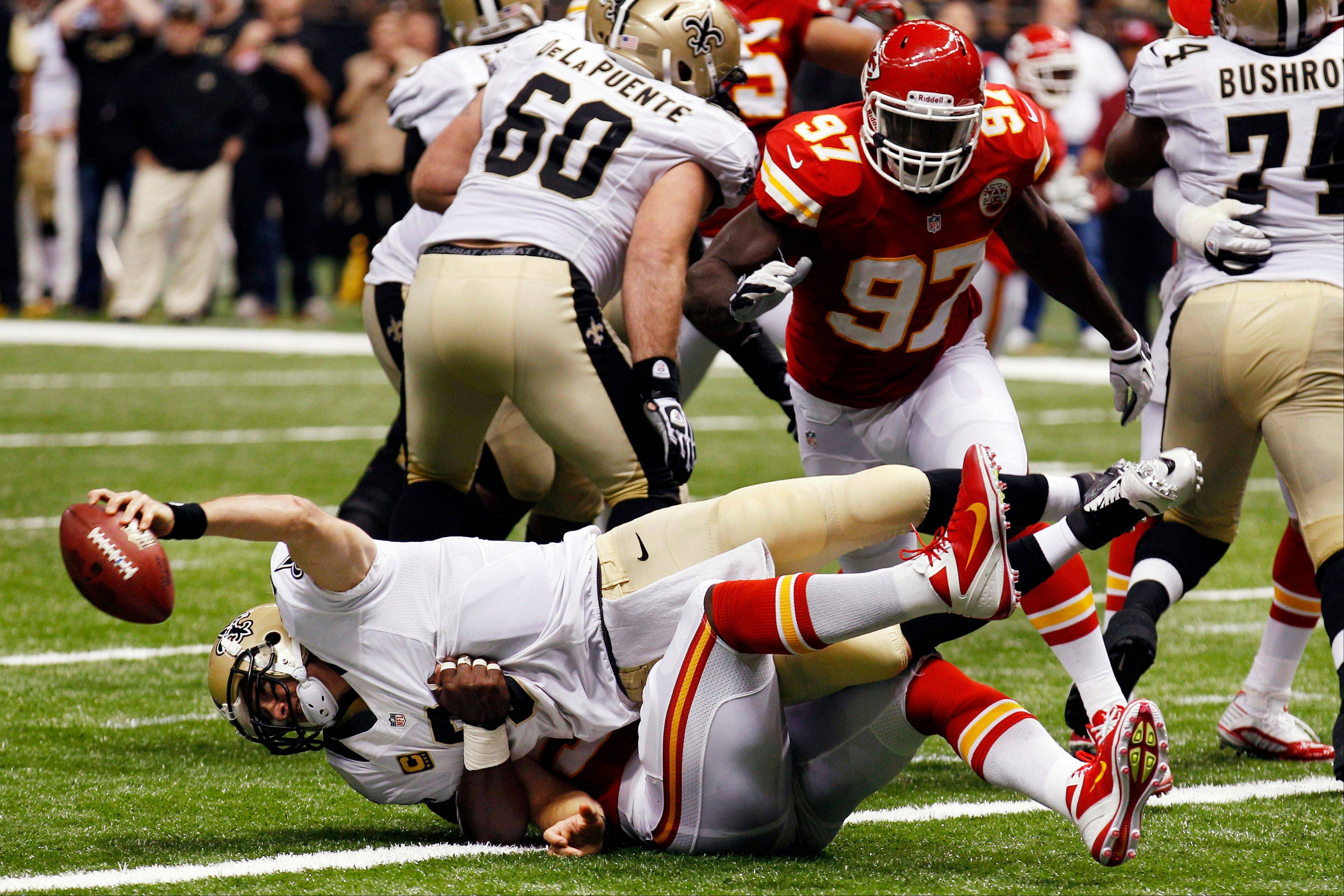 The Chiefs sack Saints quarterback Drew Brees for a safety in the second half Sunday in New Orleans.